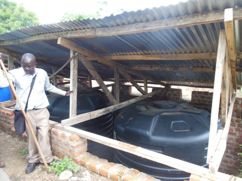 Roof water storage tanks which are part of a greenhouse irrigation system to grow food for disabled Ugandan children attending a boarding school in Kitgum, UG.