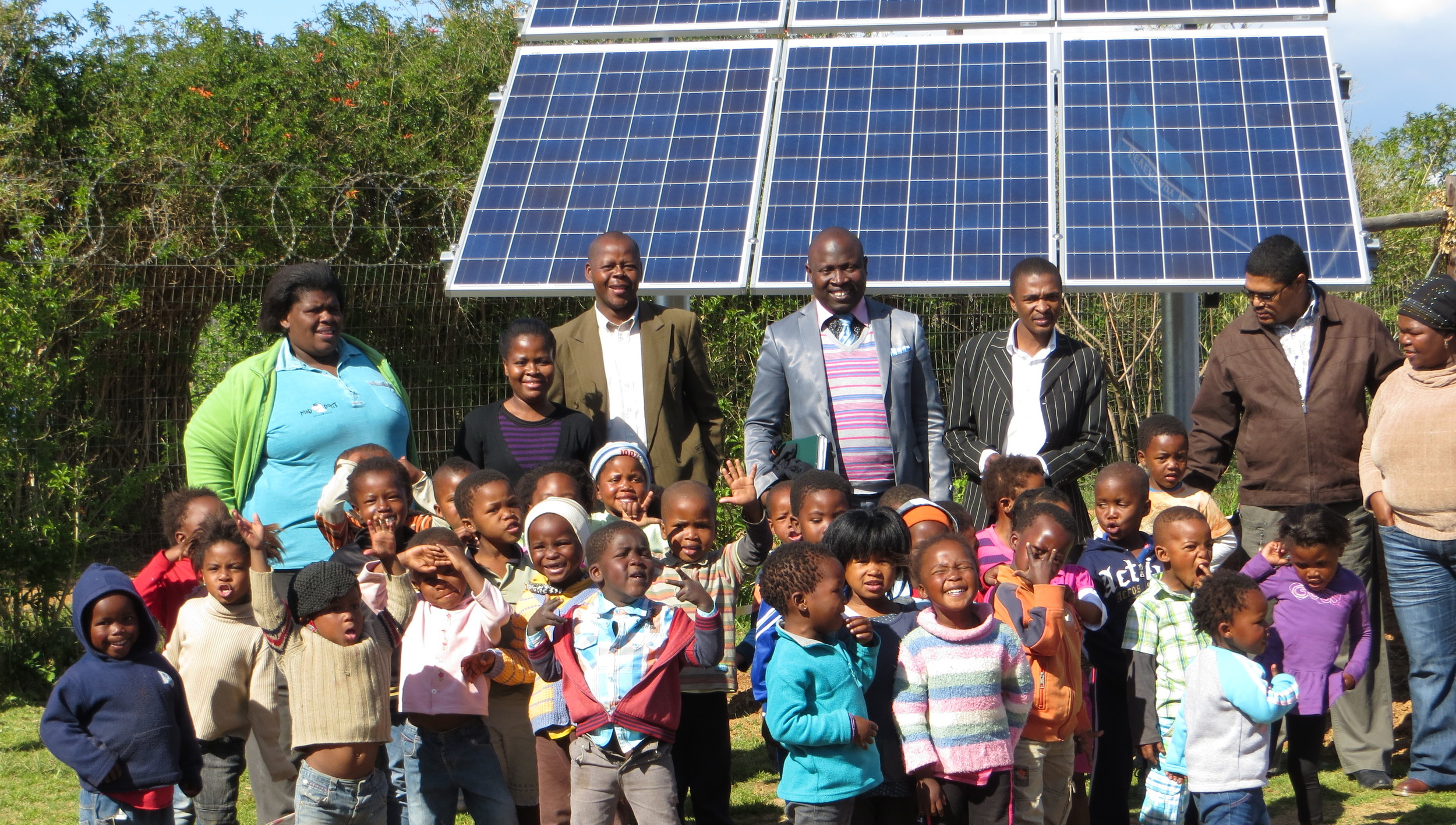 Celebrating the installation of the wind turbine and solar panels that power the community center and nursery school!