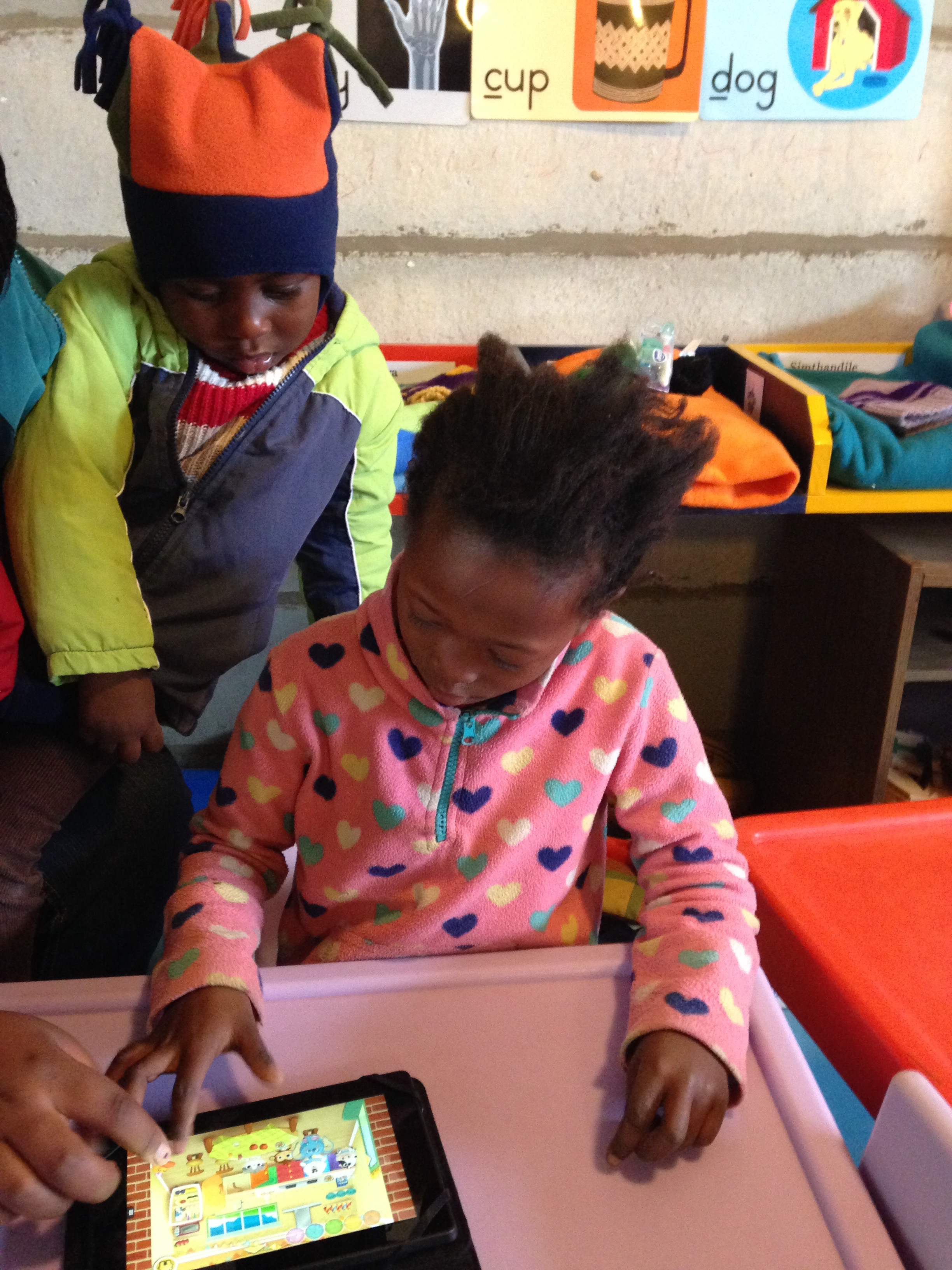 kindergarten learner playing an academic game on a brand new kindle tablet
