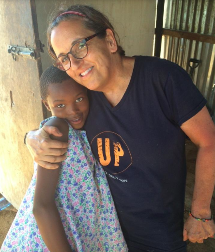 CUMmings with veronica, a grateful recipient of UP's efforts in south africa