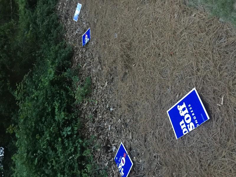 Vandalized Ossoff signage