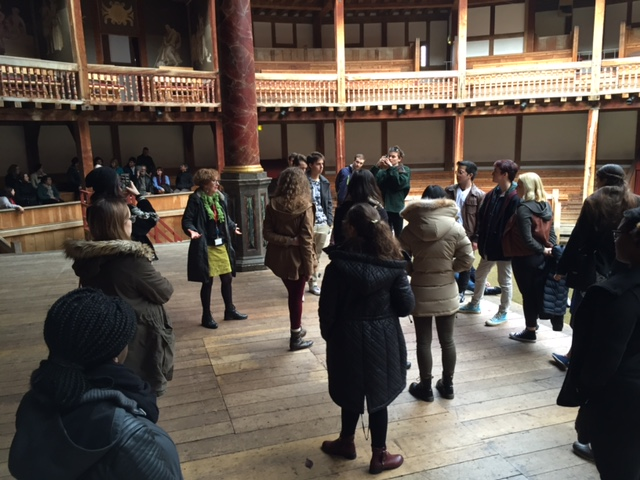 Standing onstage at The Globe with our workshop facilitator, Mary (green skirt).