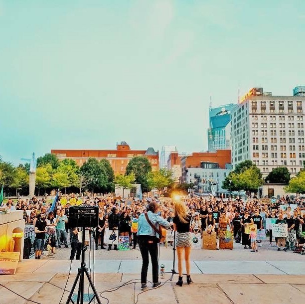 I am so grateful and honored to have gotten to perform at the Nashville #climatestrike Friday night. ✊🏻🌎 It was humbling to see so many people showing up,  standing up, speaking out and taking action to save our planet! 🙌🏻😍 We felt such a great sense of hope  and optimism seeing millions of people around the world #takeaction for #climatechange. But alongside the hope, we feel an overwhelming sense of anxiety and fear 🥺..... does anyone else have such conflicting feelings ?  Getting to sing our song From The Dark, which deals with feelings of anxiety and fear, on the day of the #globalclimatestrike felt cathartic for us. 💕  Together we can all secure a healthy and beautiful future for ourselves, our kids, grandkids and generations to come! 🌍🌈🌟 Let's go save the world!! Which sounds pretty badass.... 🦸🏼♀️🦸🏾♀️🦸🏽♂️🦸🏻♂️ 🌟Listen to From the Dark: http://smarturl.it/from-the-dark LINK IN BIO .🌟 . . . . #climatechange #newmusic #americana #acoustic #mentalhealthawareness #folkpop #folkmusic #musicforanxiety #musicfordepression #healingmusic #nashvillemusic #itsoktonotbeok #emotionalhealing #anxietyrelief #taylorguitar #taylorplayer