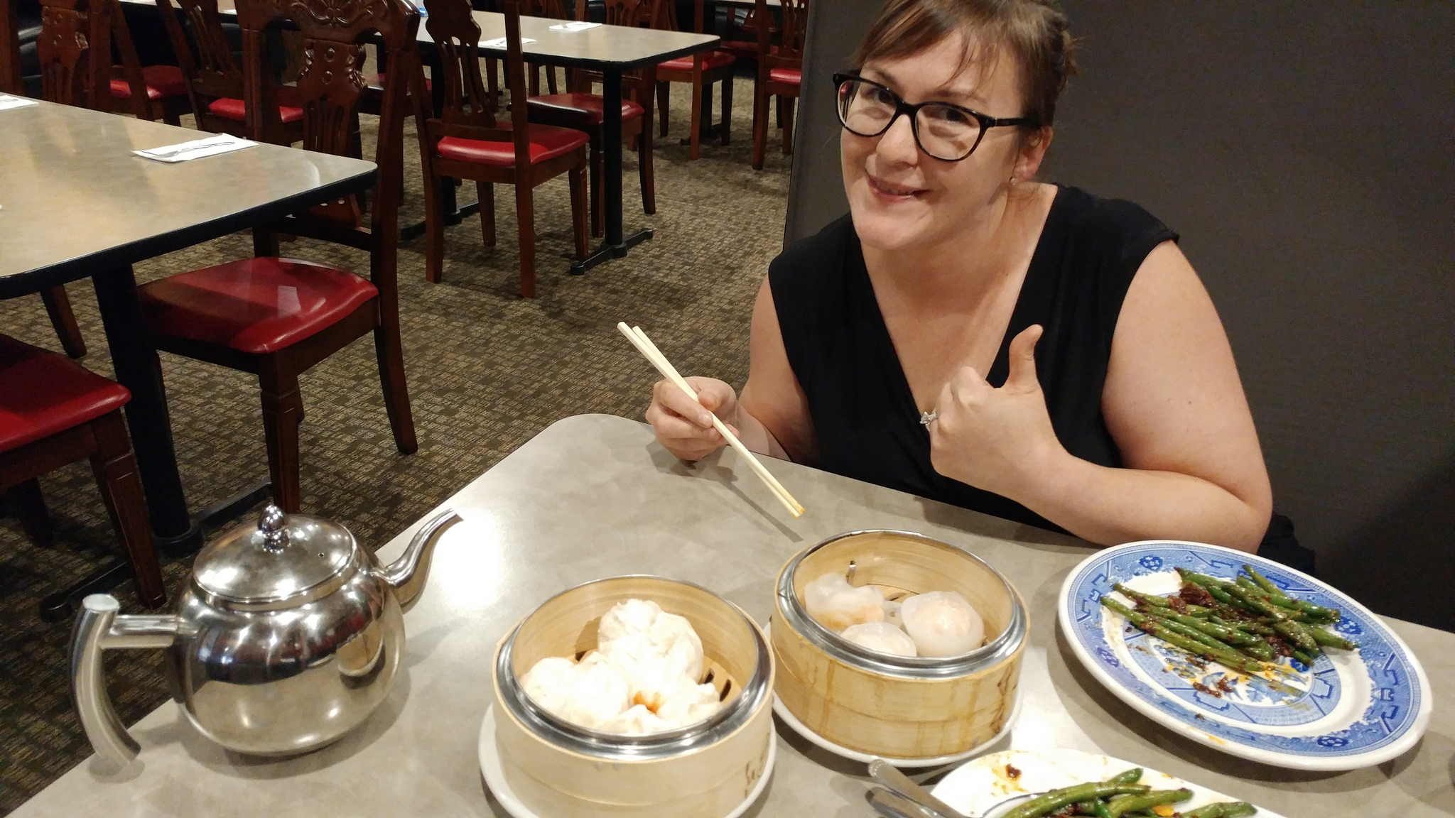 My lunch buddy and a few of our dim sum choices.