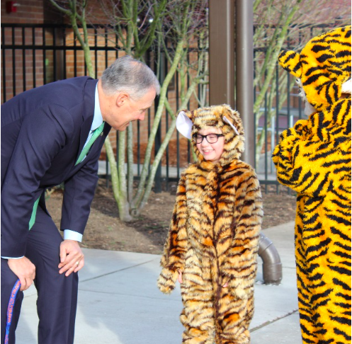 Governor Jay Inslee talks to a Garfield Tiger in January 2017. He was there to tour the school and learn about how counsellors and teachers collaborate with each other to support students.