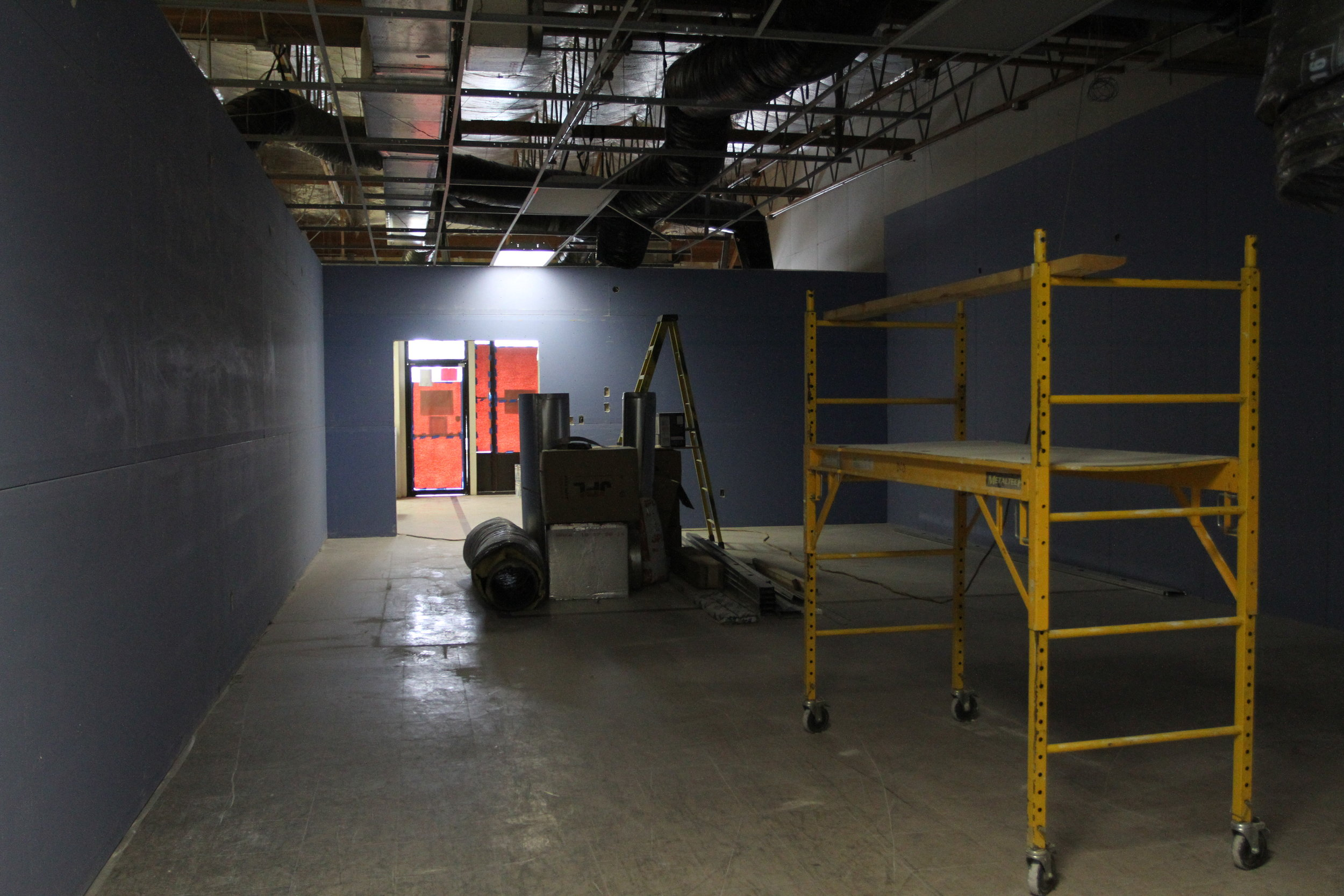 Still in the process of being built, the studio walls are made of special moisture-resistant drywall to keep up with the sweat and heat. One wall will be covered in floor to ceiling mirrors.