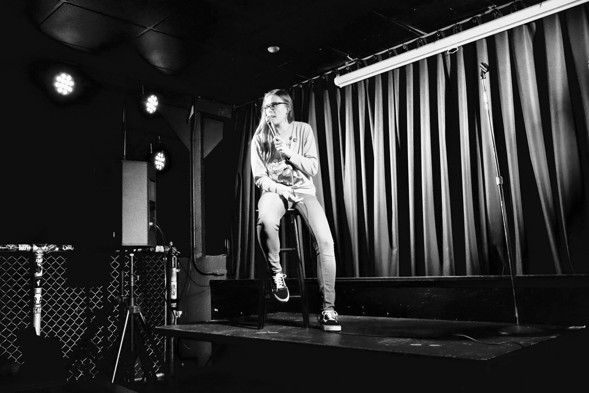 Megan K proving stand up comedy does not require standing // Garret Hunt