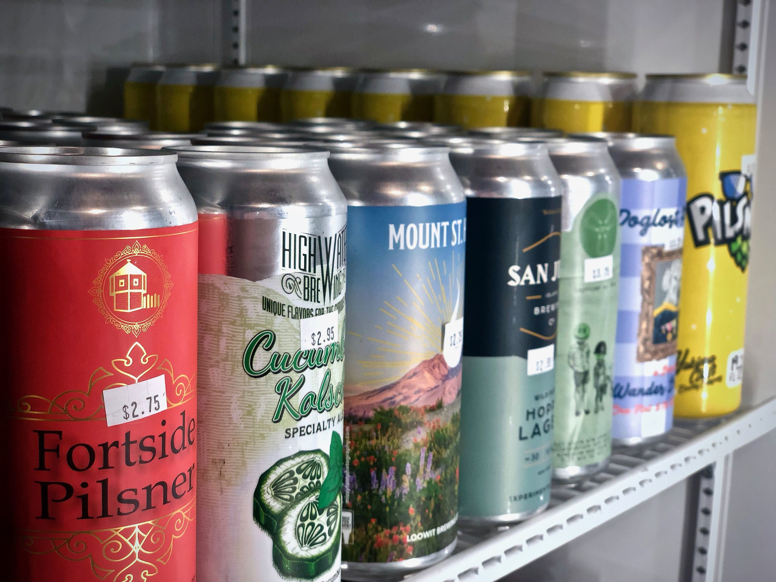 Cans at Toggle's Bottle Shop ready to be enjoyed // Henry J