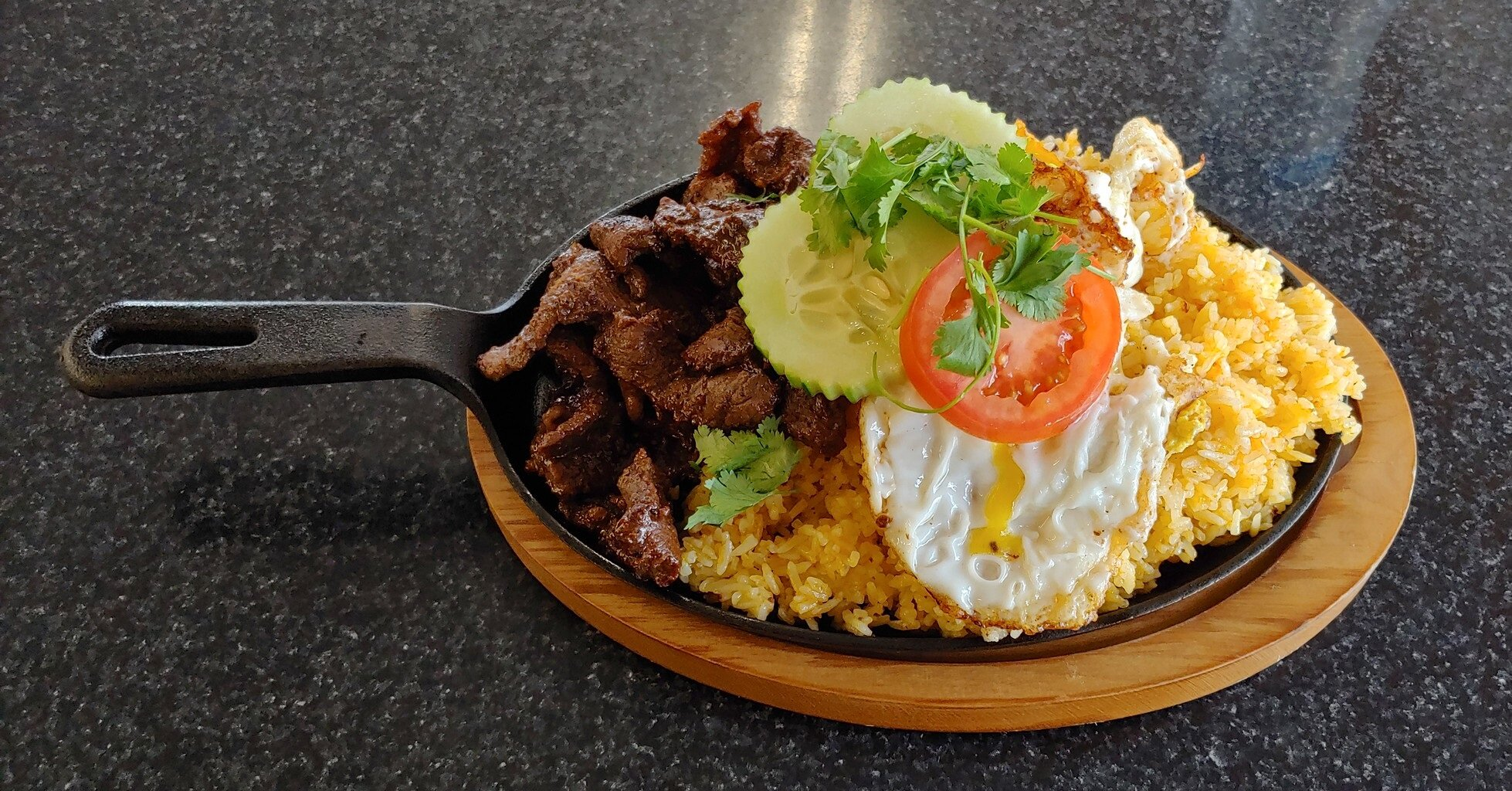Marinated beef, garlic fried rice and a crispy fried egg // Christopher Bragg