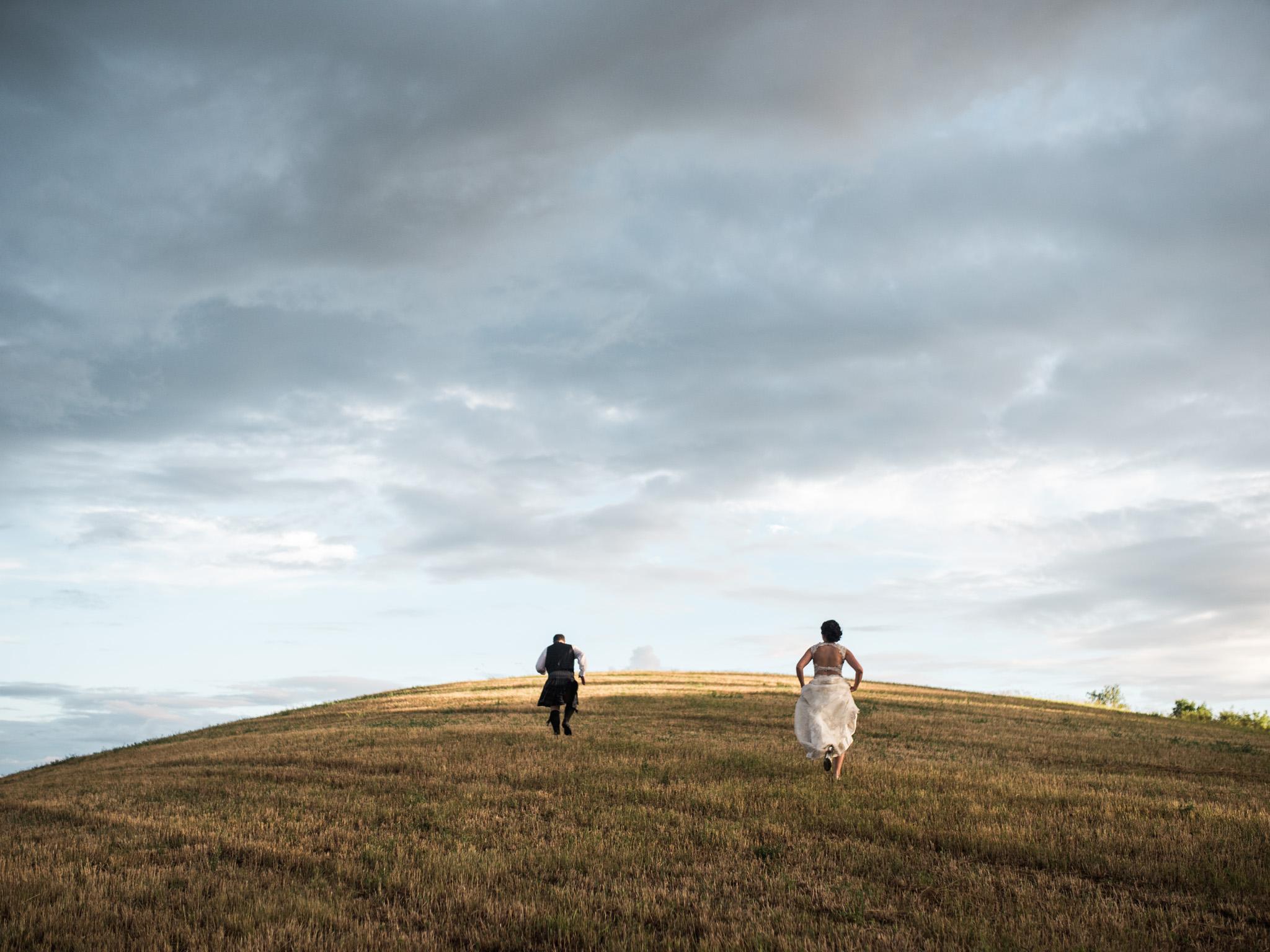barn wedding with wedding couple