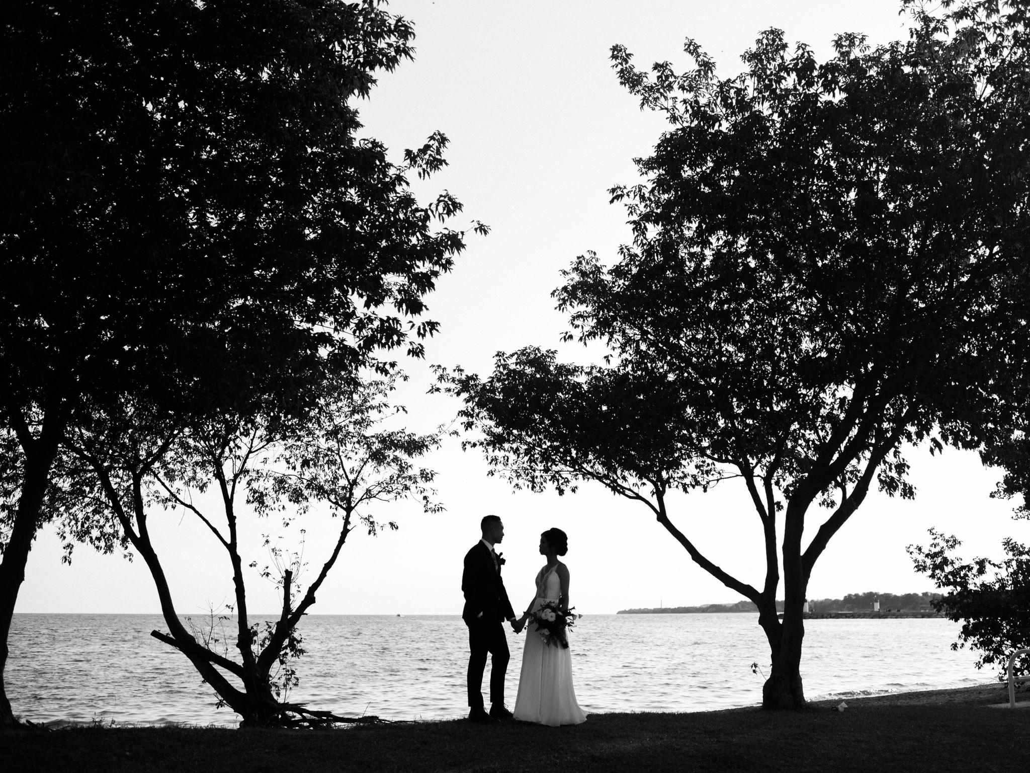symmetrical wedding portrait at the lakefront