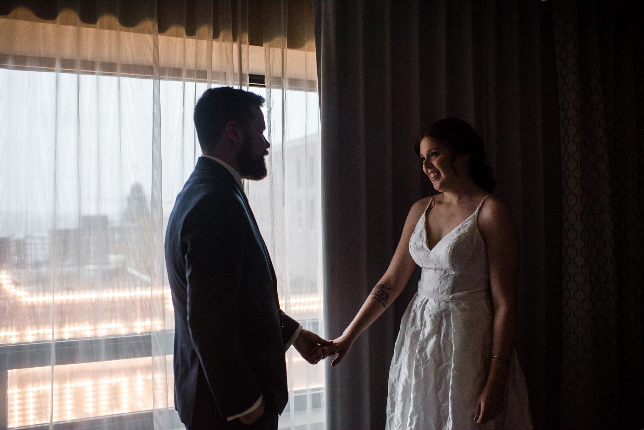130-wedding-couple-getting-ready-toronto-hotel-rainy-day-photographer.jpg