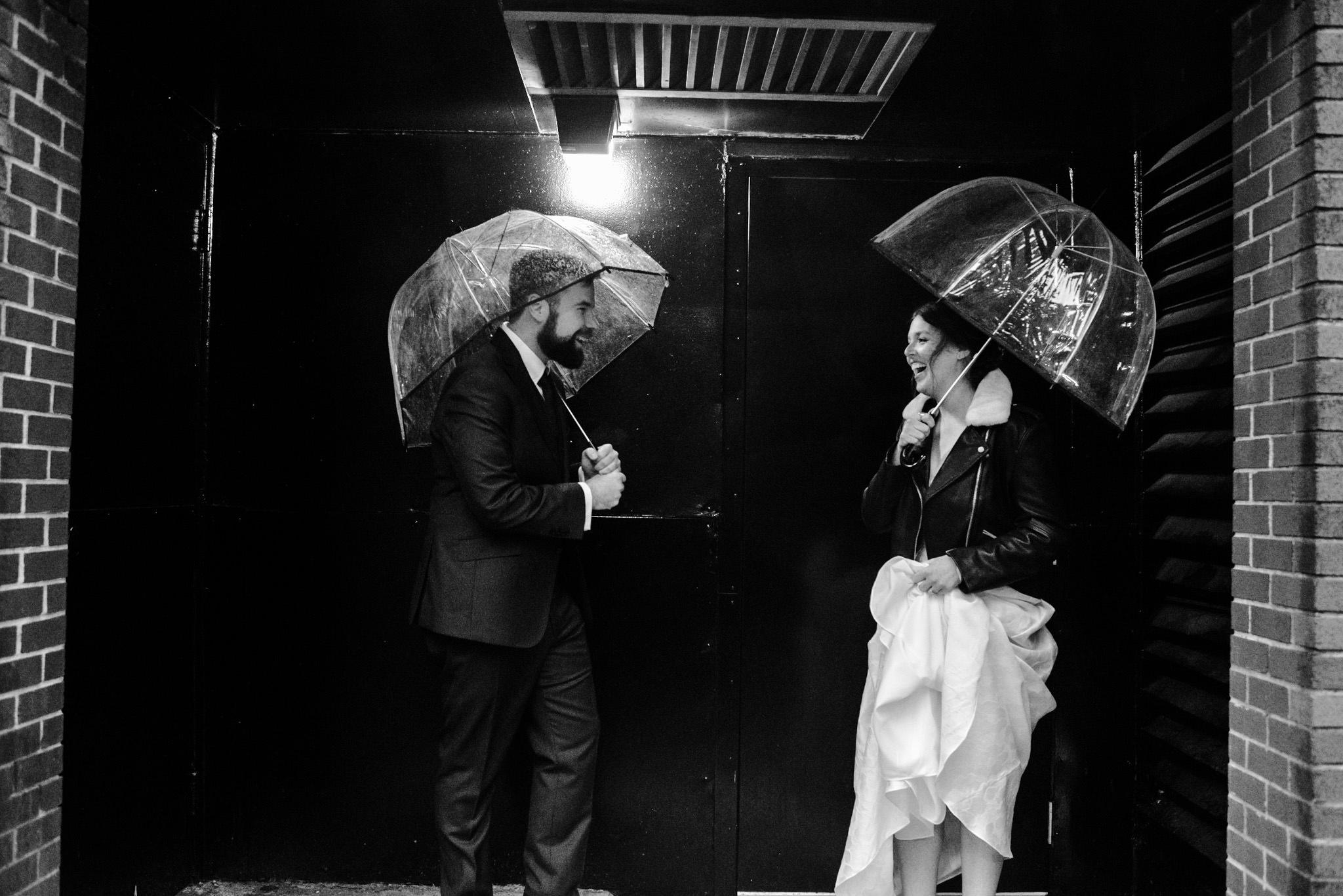 127-rainy-day-wedding-toronto-wedding-photographer-clear-umbrellas.jpg