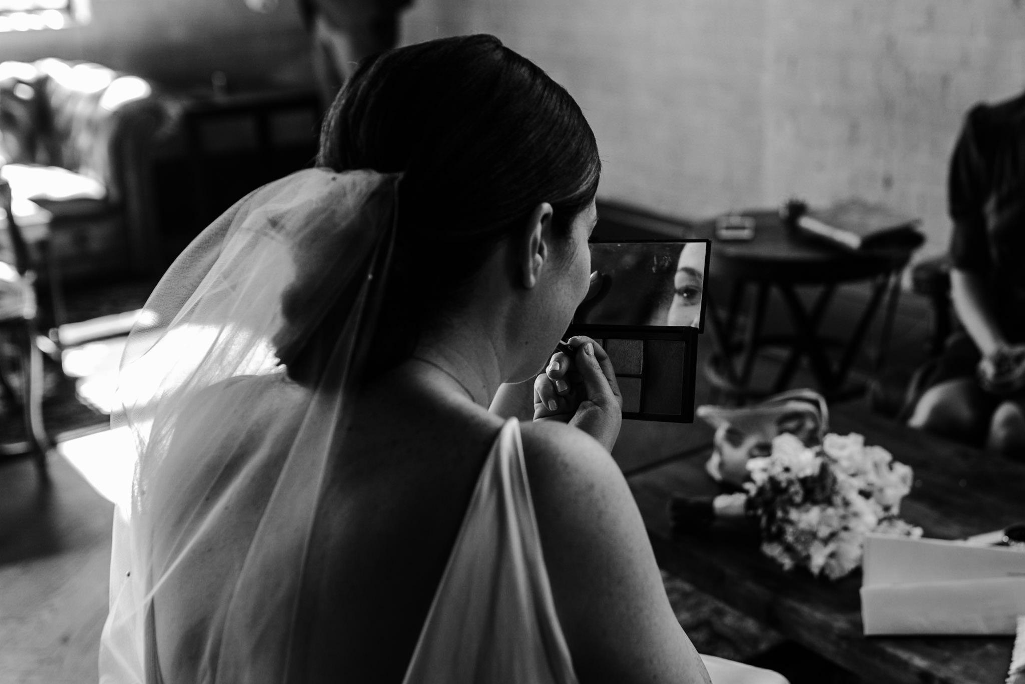 115-bride-getting-ready-storys-building-documentary-wedding-photographer.jpg