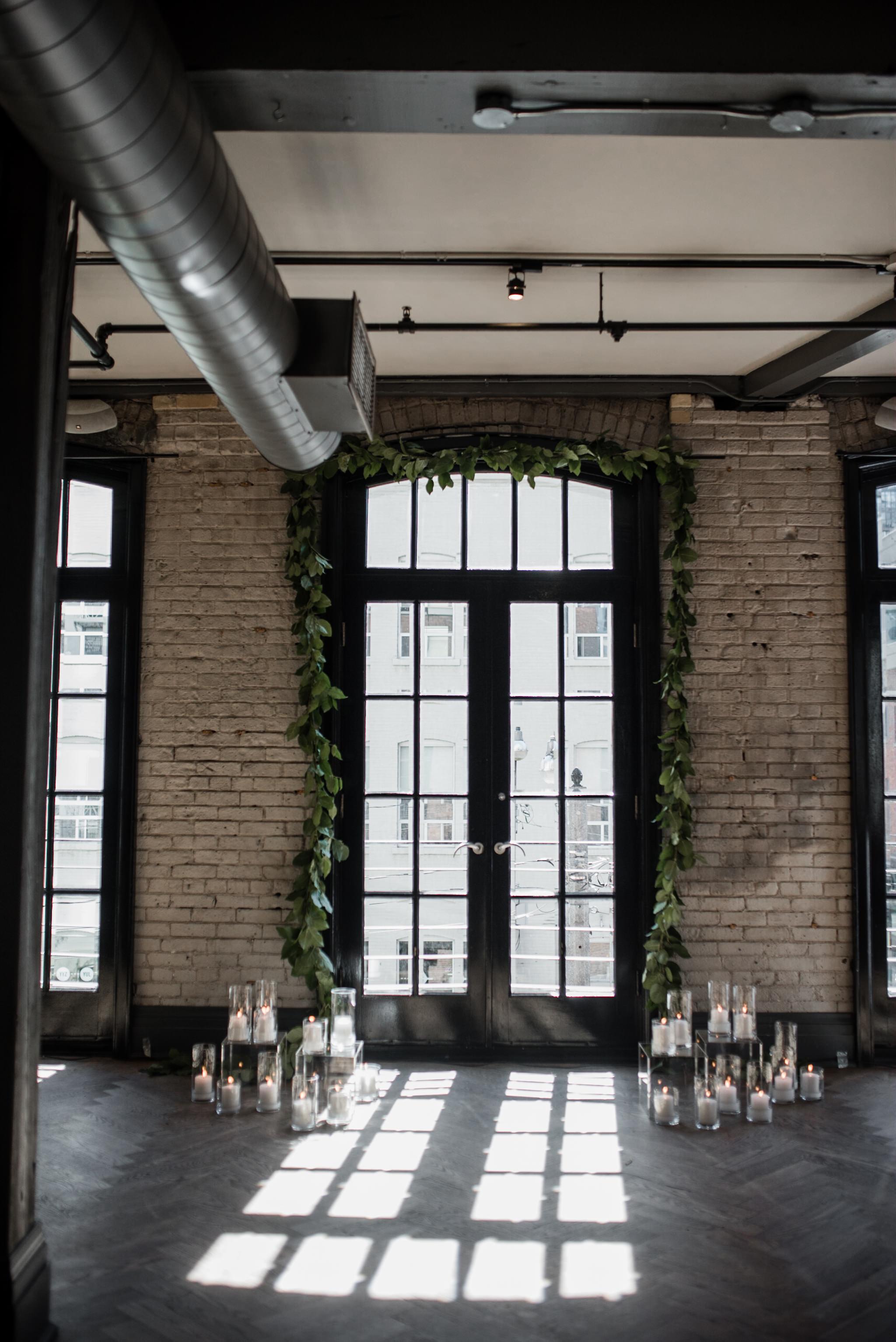 113-wedding-altar-decor-storys-building-candles-garland-industrial.jpg