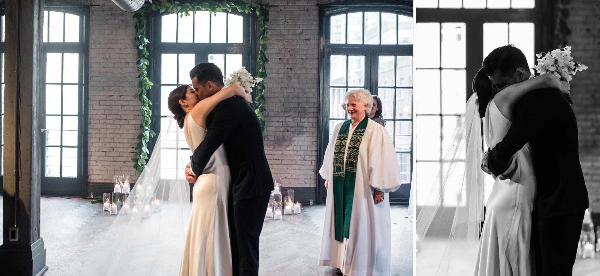 097-first-kiss-ceremony-wedding-storys-building-romantic.jpg