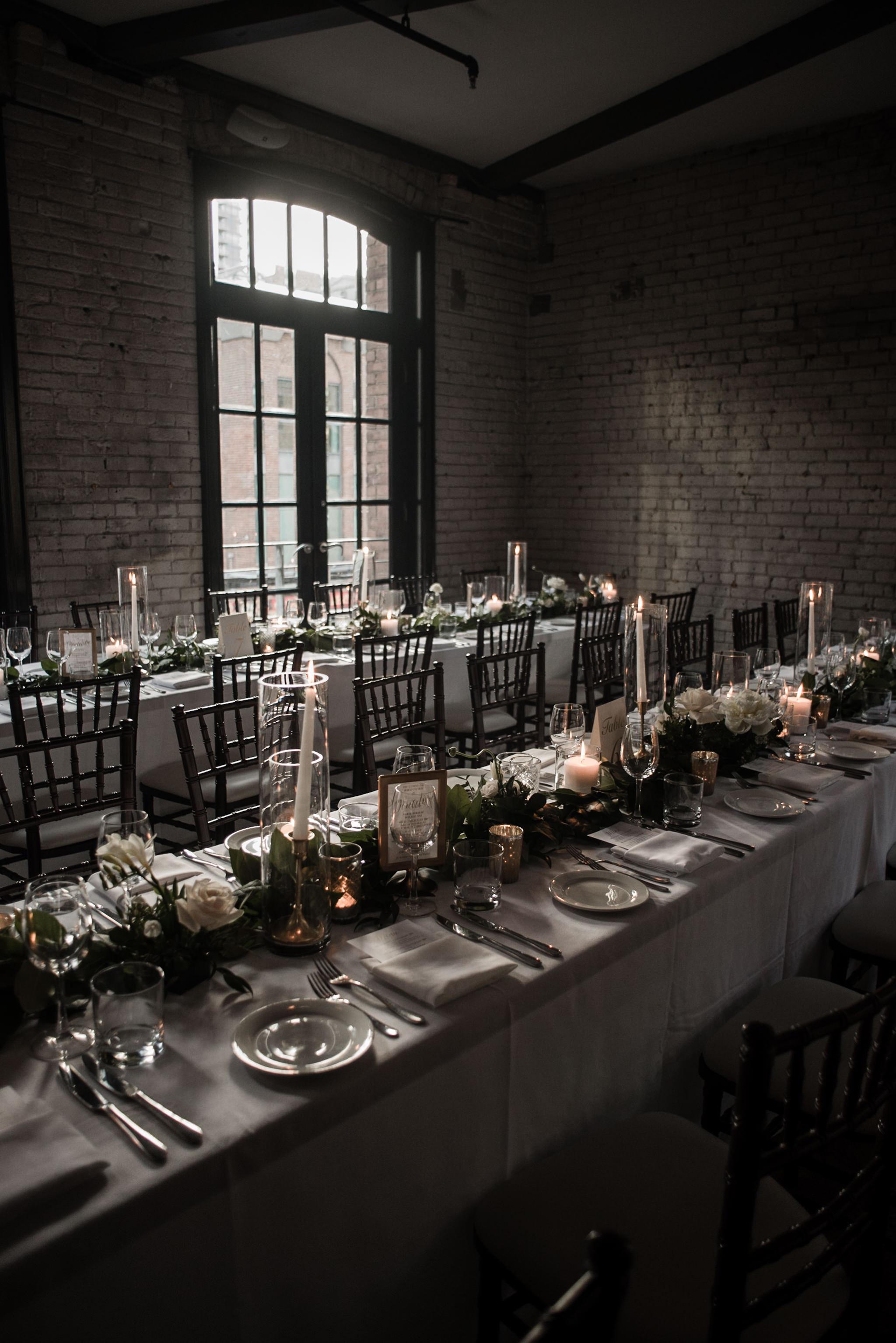 085-storys-building-reception-decor-candles-garland-romantic-industrial.jpg