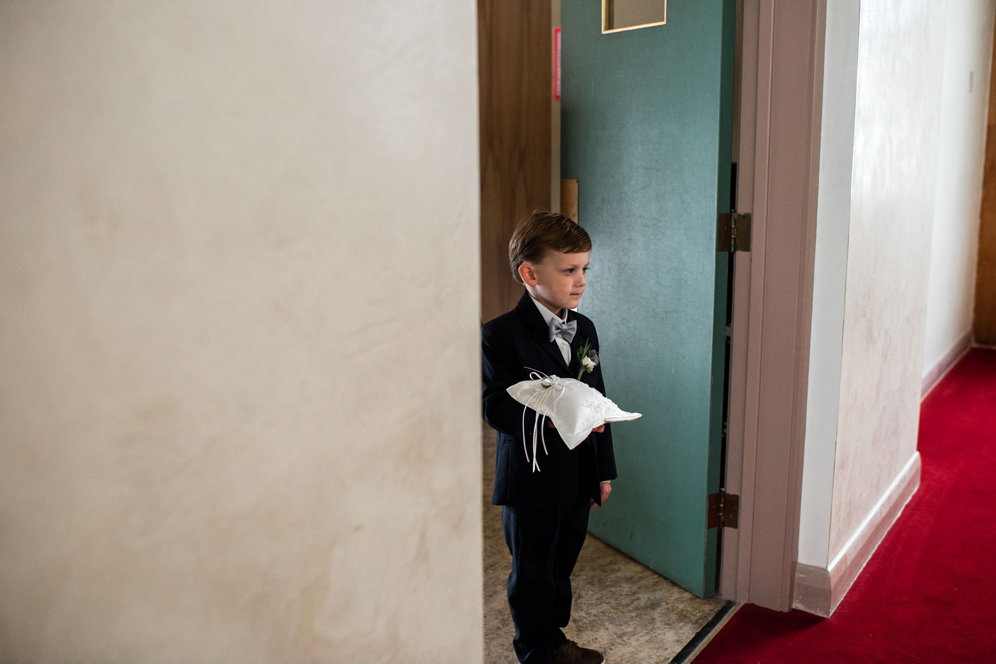 195-ring-boy-waiting-to-walk-down-aisle-muted-colours-toronto-ottawa.jpg