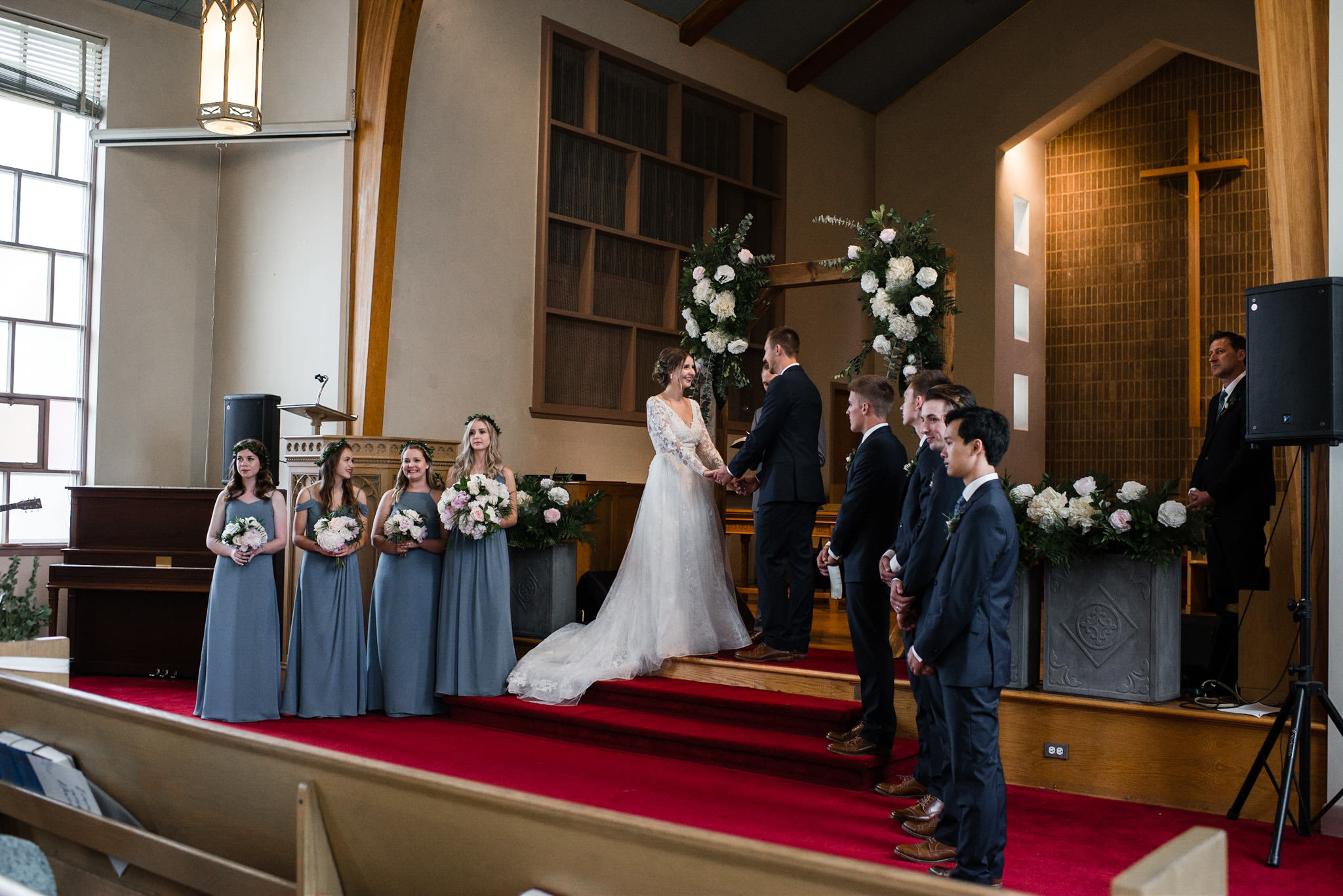 188-bride-groom-worship-toronto-church-wooden-arch-flowers.jpg