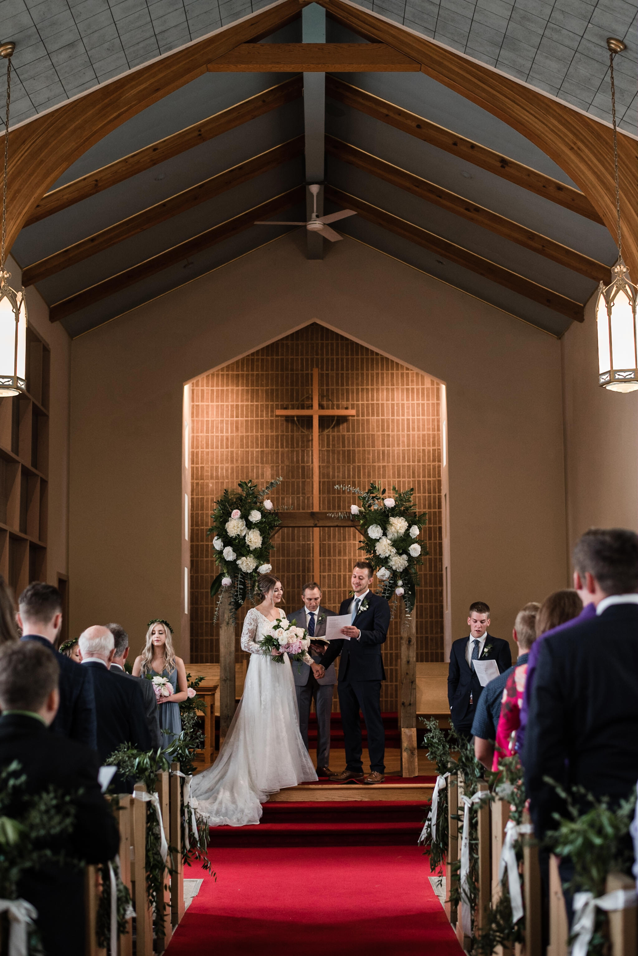 186-bride-groom-worship-toronto-church-wooden-arch-flowers.jpg