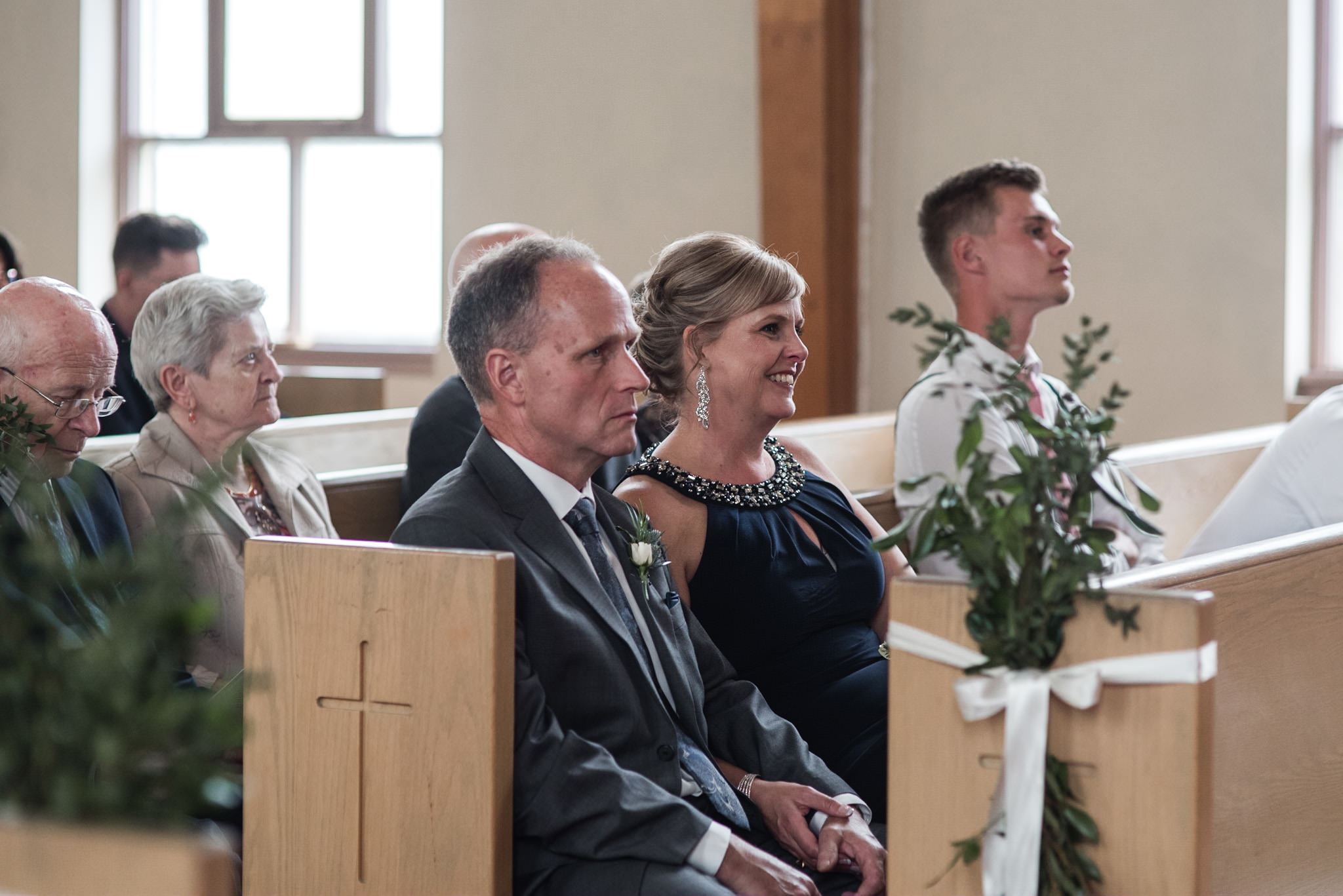 180-wedding-ceremony-candids-wooden-arch-in-church.jpg