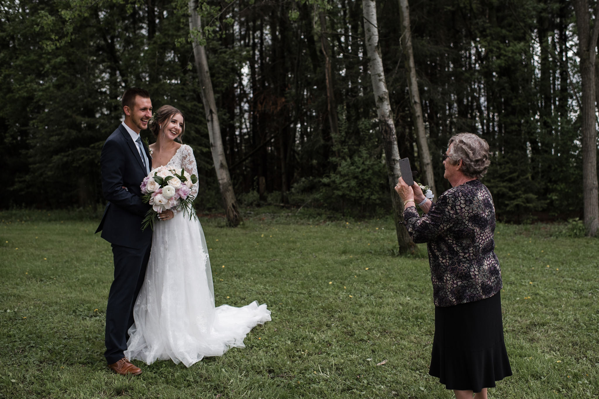 165-candid-moment-grandma-wedding-couple-forest.jpg