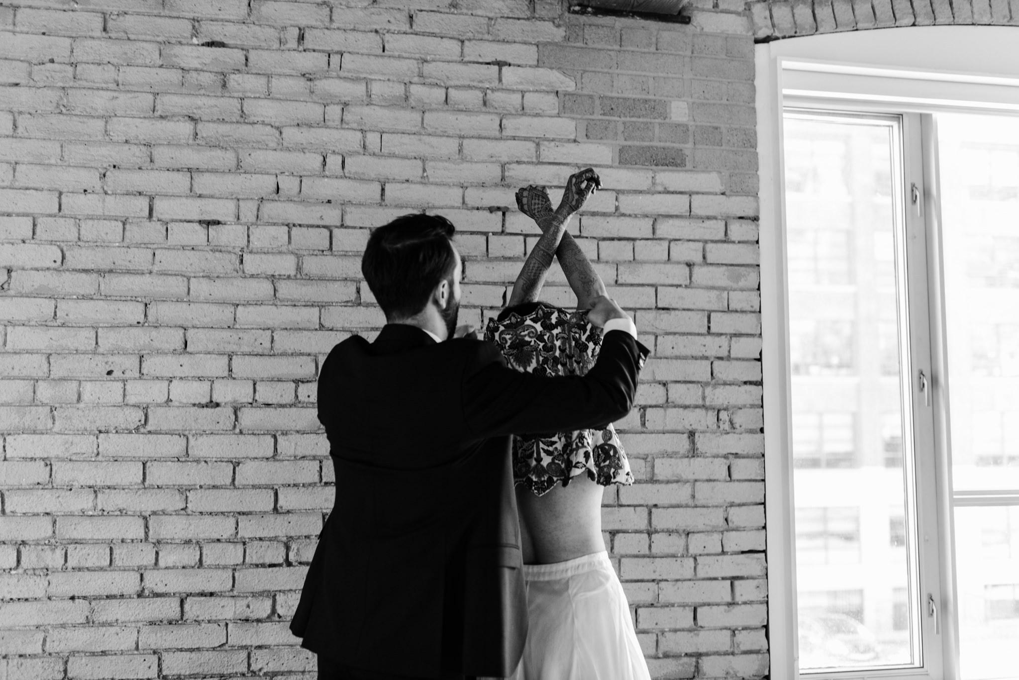 099-bride-groom-getting-ready-together-hotel-ocho-wedding-intimate-photos.jpg