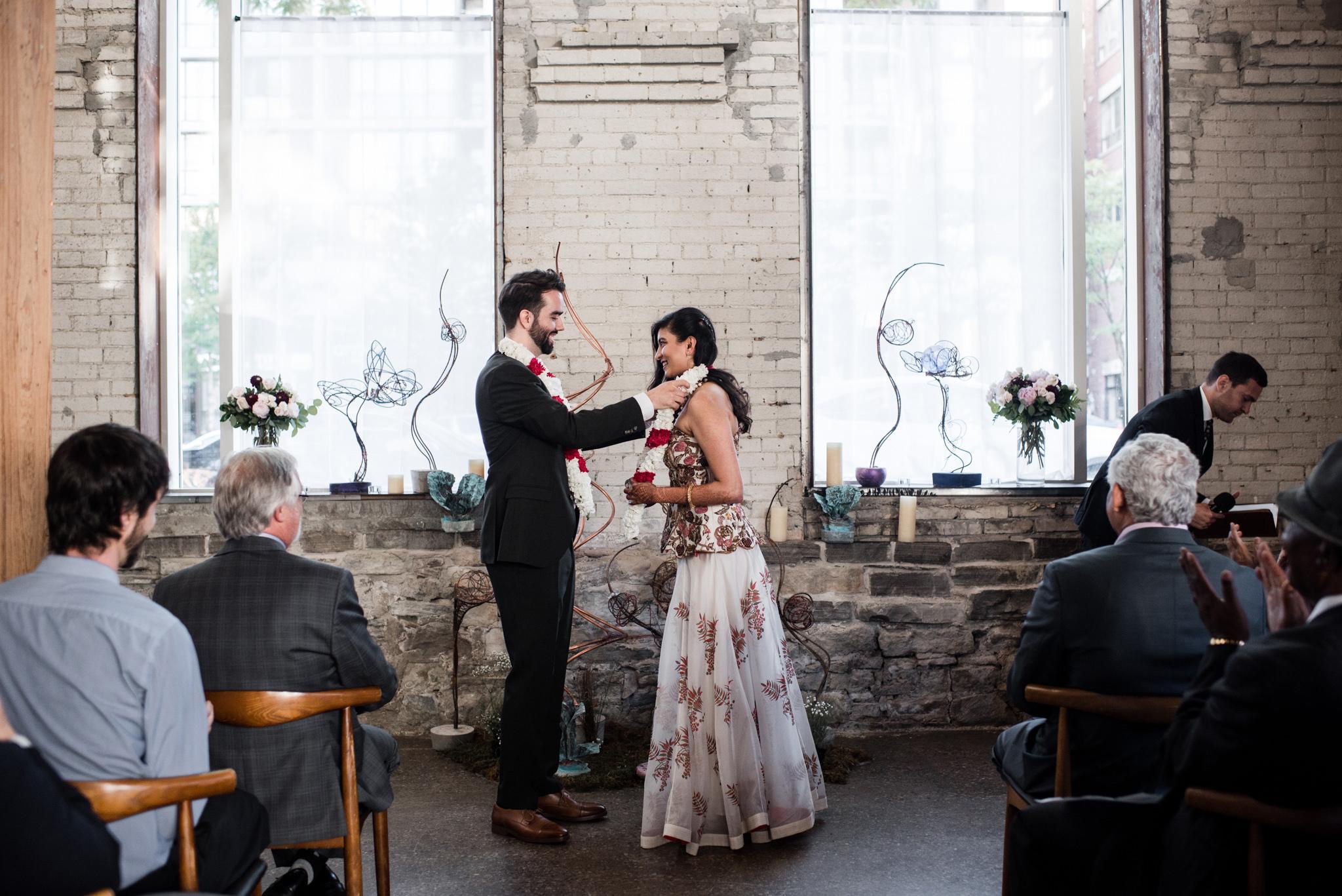 073-ring-wedding-bride-groom-ceremony-toronto-downtown-photos.jpg