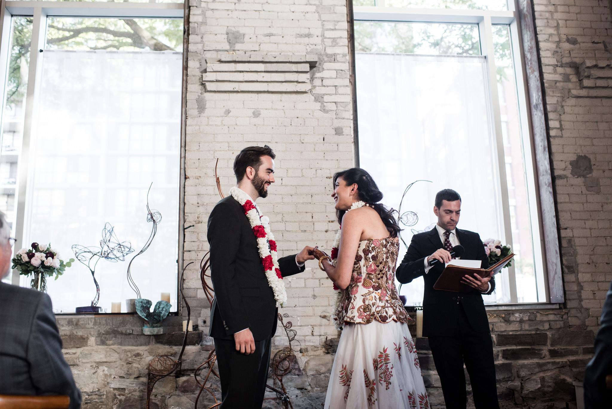 071-ring-wedding-bride-groom-ceremony-toronto-downtown-photos.jpg