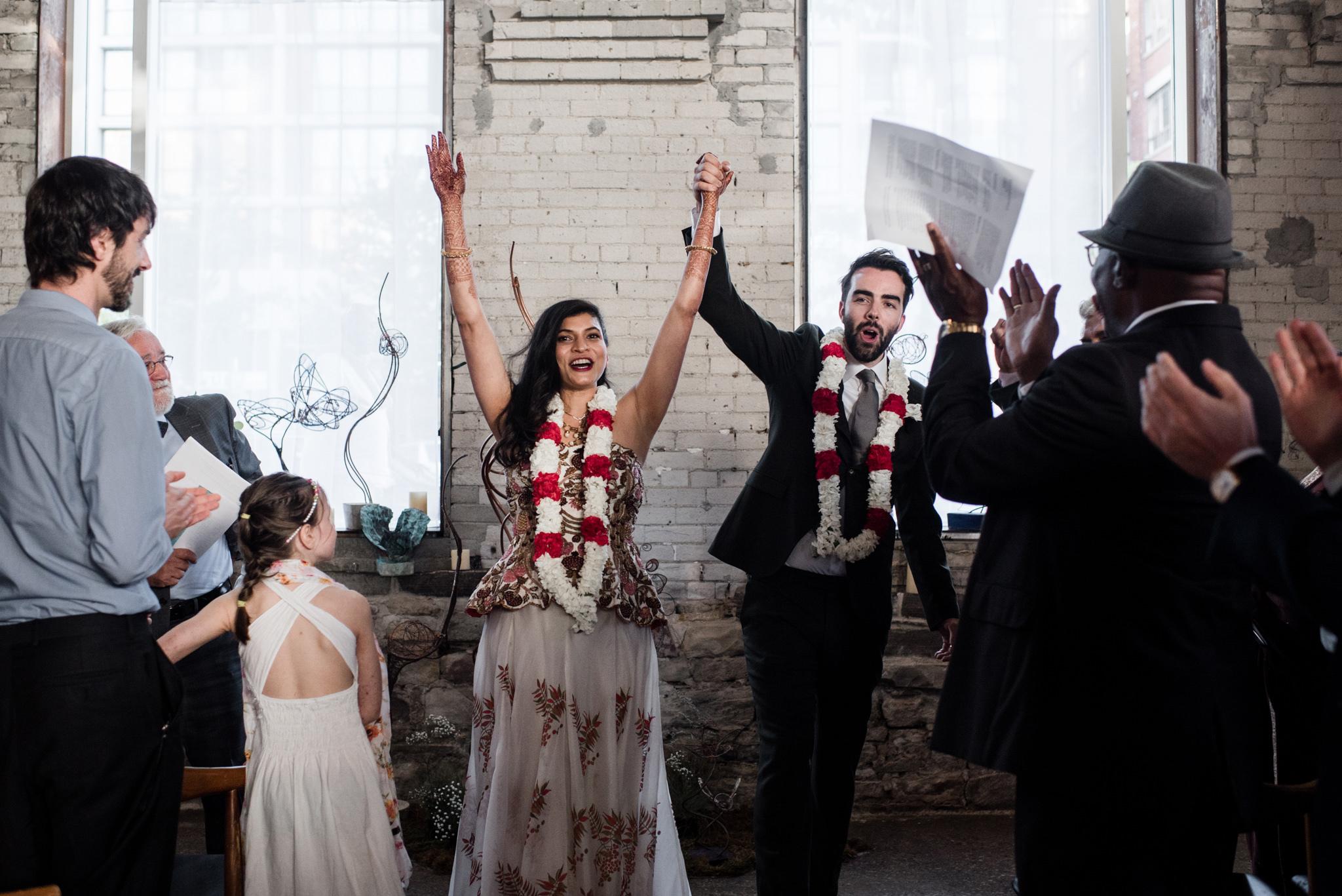 066-wedding-ceremony-reception-recessional-bride-groom-exit-photographer.jpg