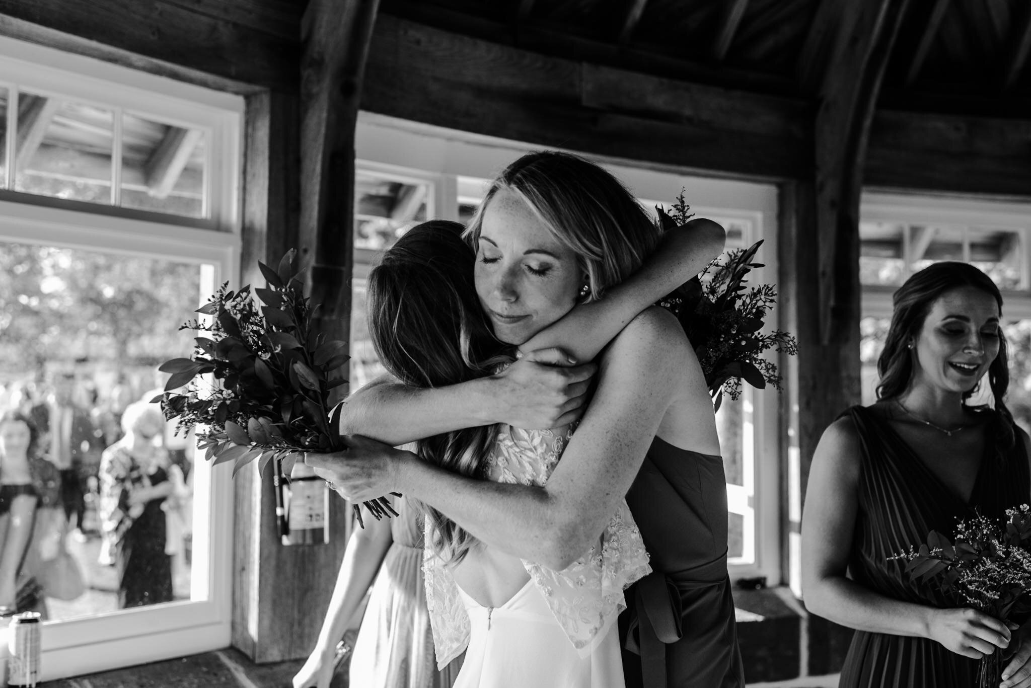 191-sister-bride-cute-moment-post-ceremony-candid-storytelling-wedding-minister-island.jpg