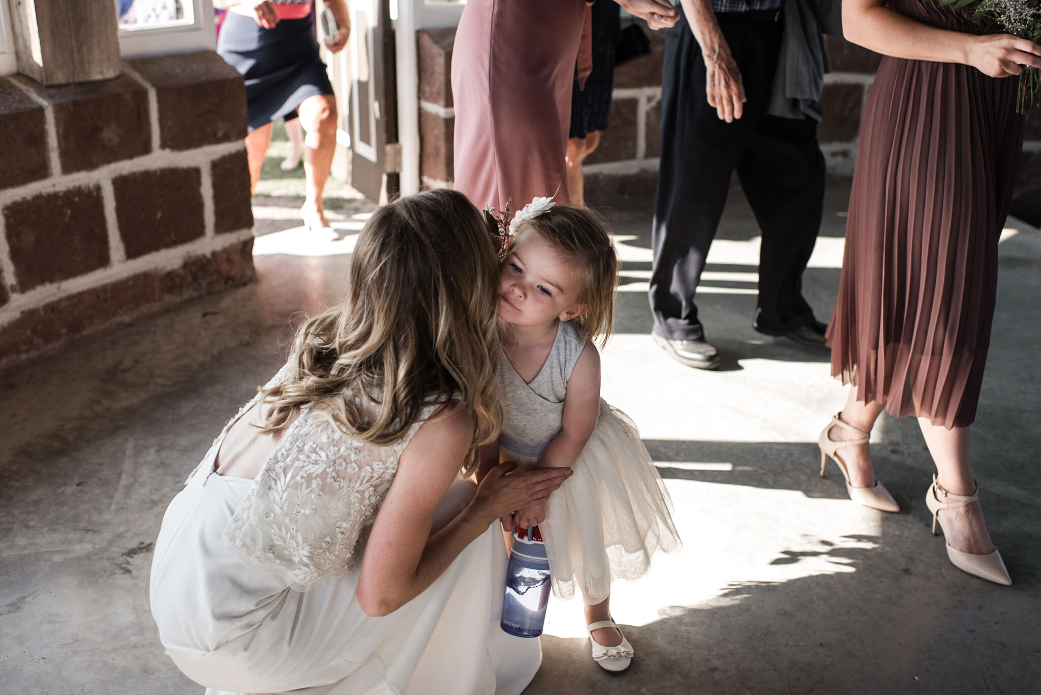 190-cute-flower-girl-bride-moment-post-ceremony-cocktail-ministers-island-st-andrews-by-the-sea-photos.jpg
