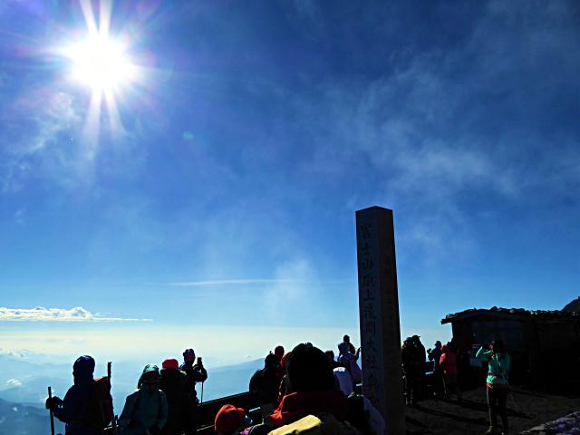 A stone monument of Kusushi Shrine stands high at the summit of Yoshidaguchi climbing trail