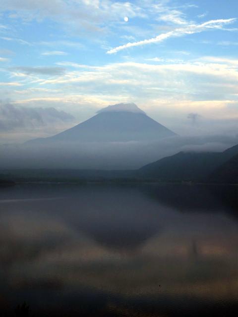 'Sakasafuji', inverted reflection of Mt. Fuji, dimly seen on the lake surface at Lake Motosuko