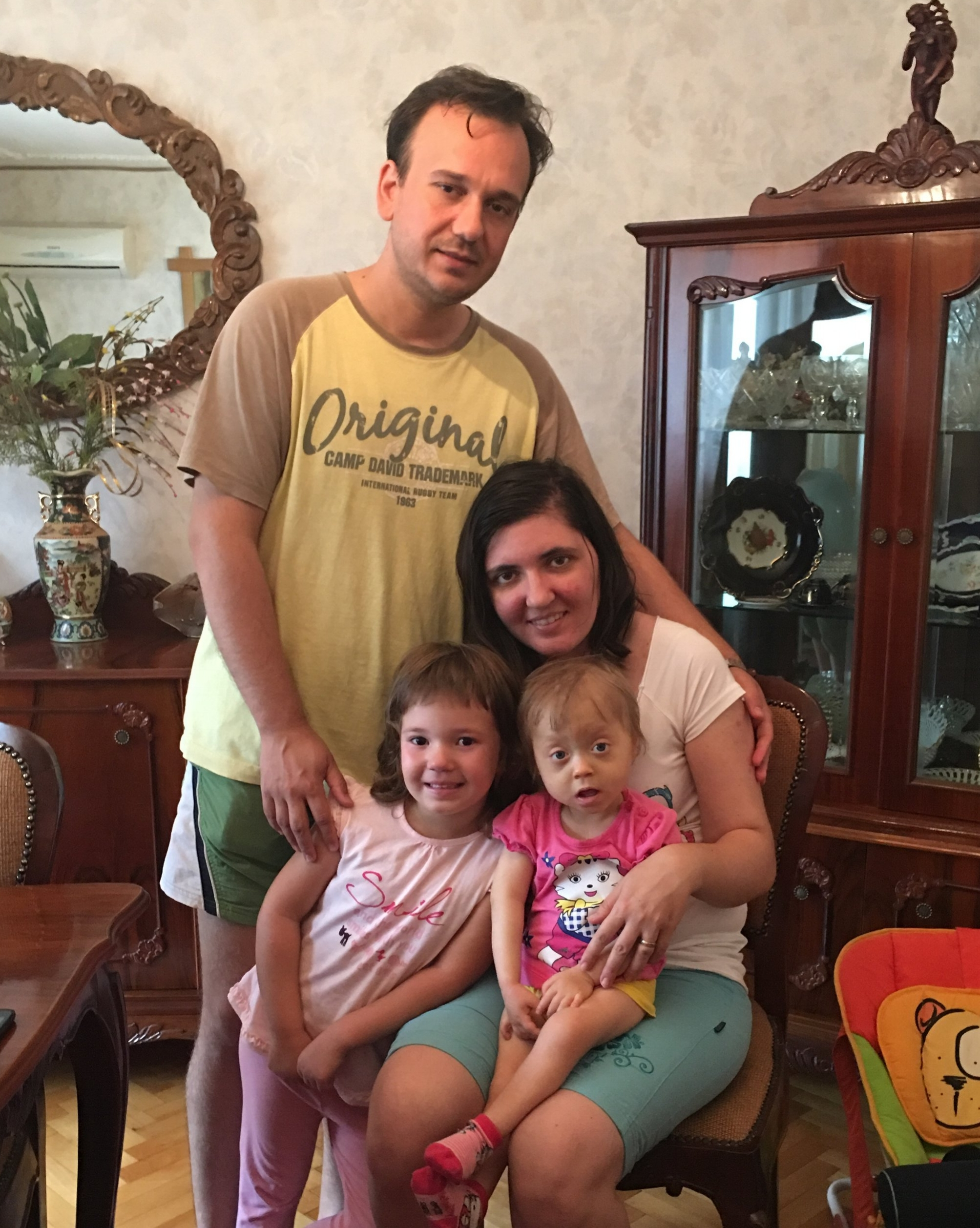 Laurean and Lavinia Vostinar with their daughters, Lidiana and Doriana - Arad, Romania