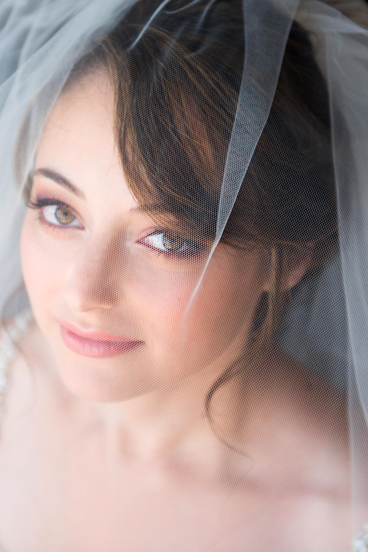 bridal green eyes bride purple eyeshadow coral lips by beauty affair.jpg