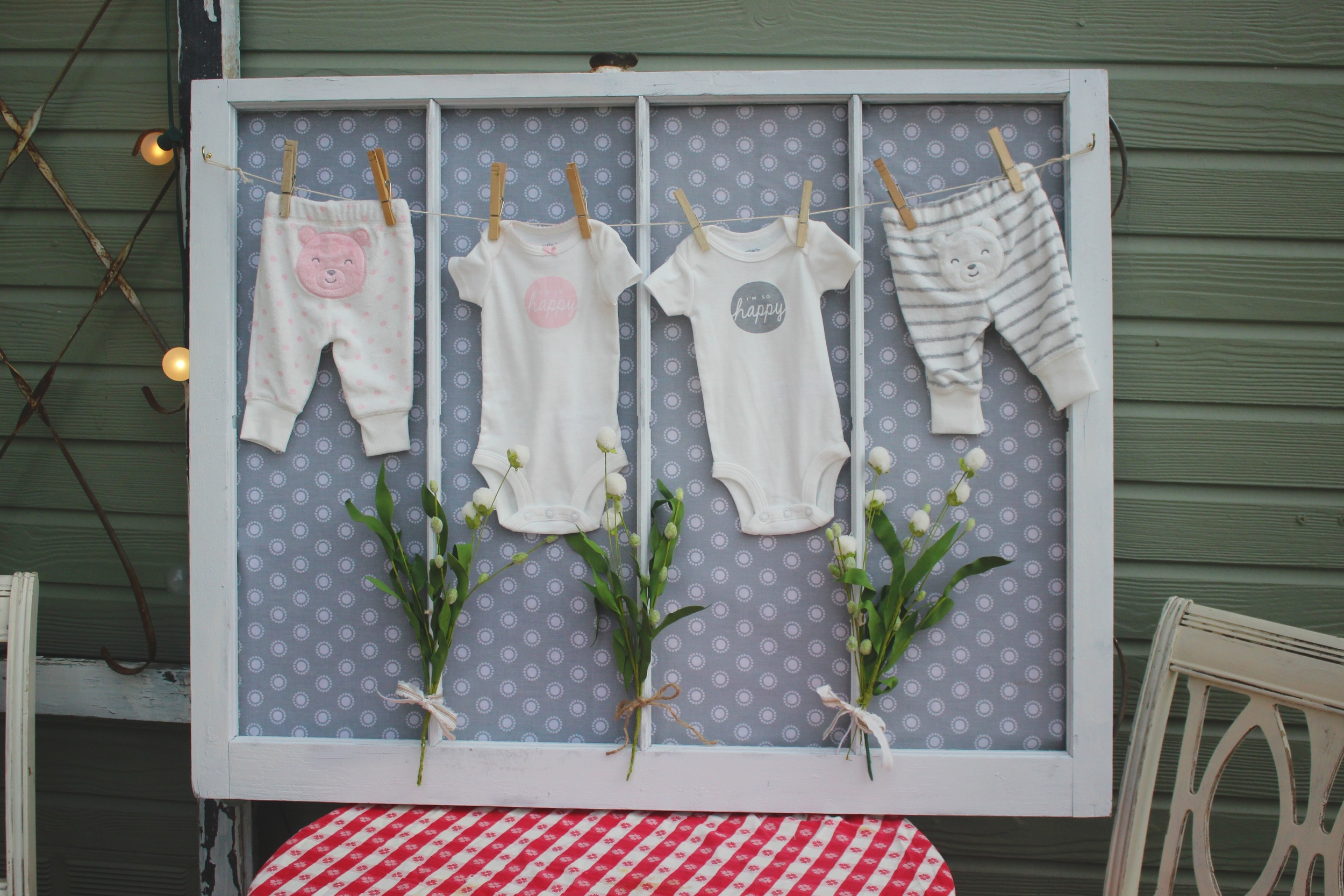 So cute! Simple backyard gender reveal party. Use an old window to display boy and girl onesies!