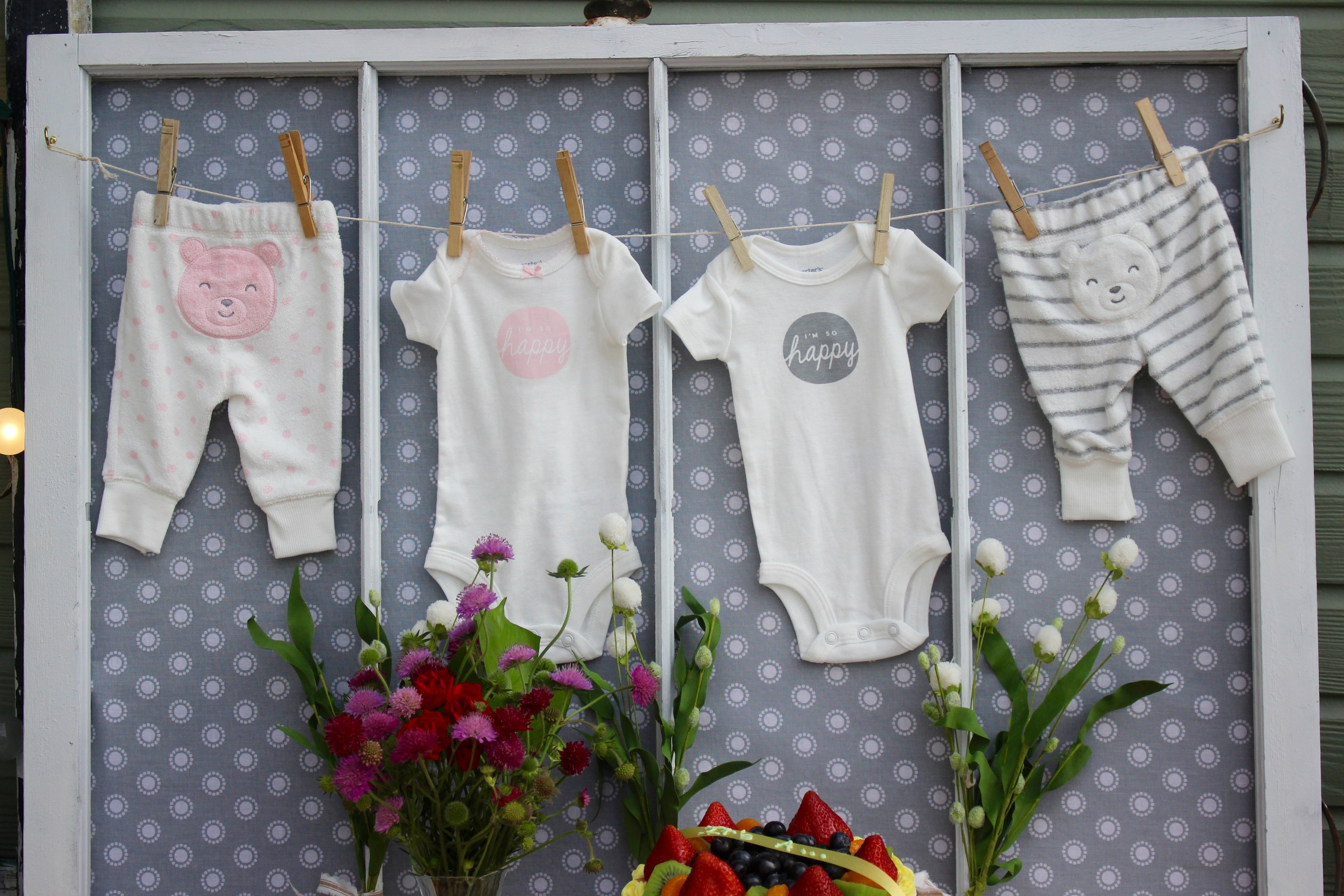 Gender reveal idea: use an old window to display cute boy and girl onesies!