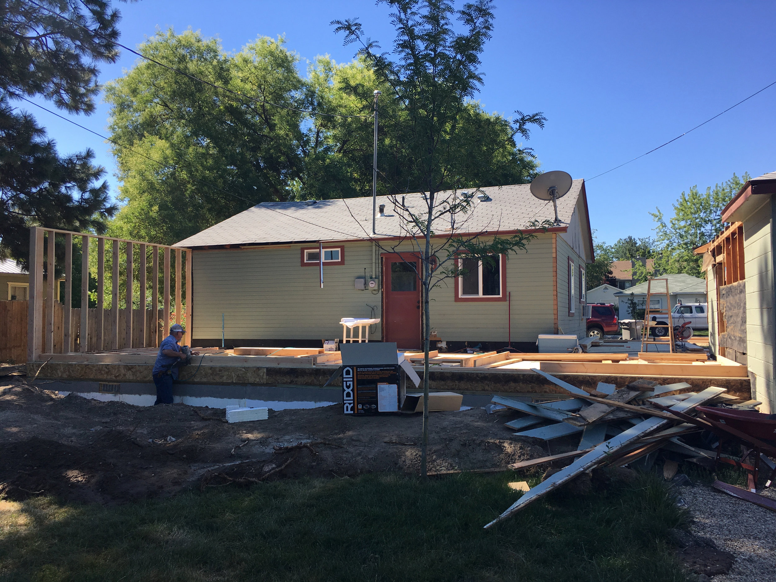 June 2016: foundation and framing going on around our tiny 700-square foot home.
