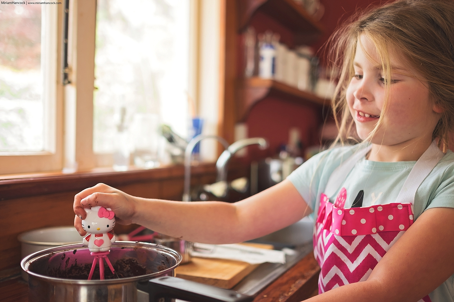 Still mixing everything together with her Hello Kitty whisk.