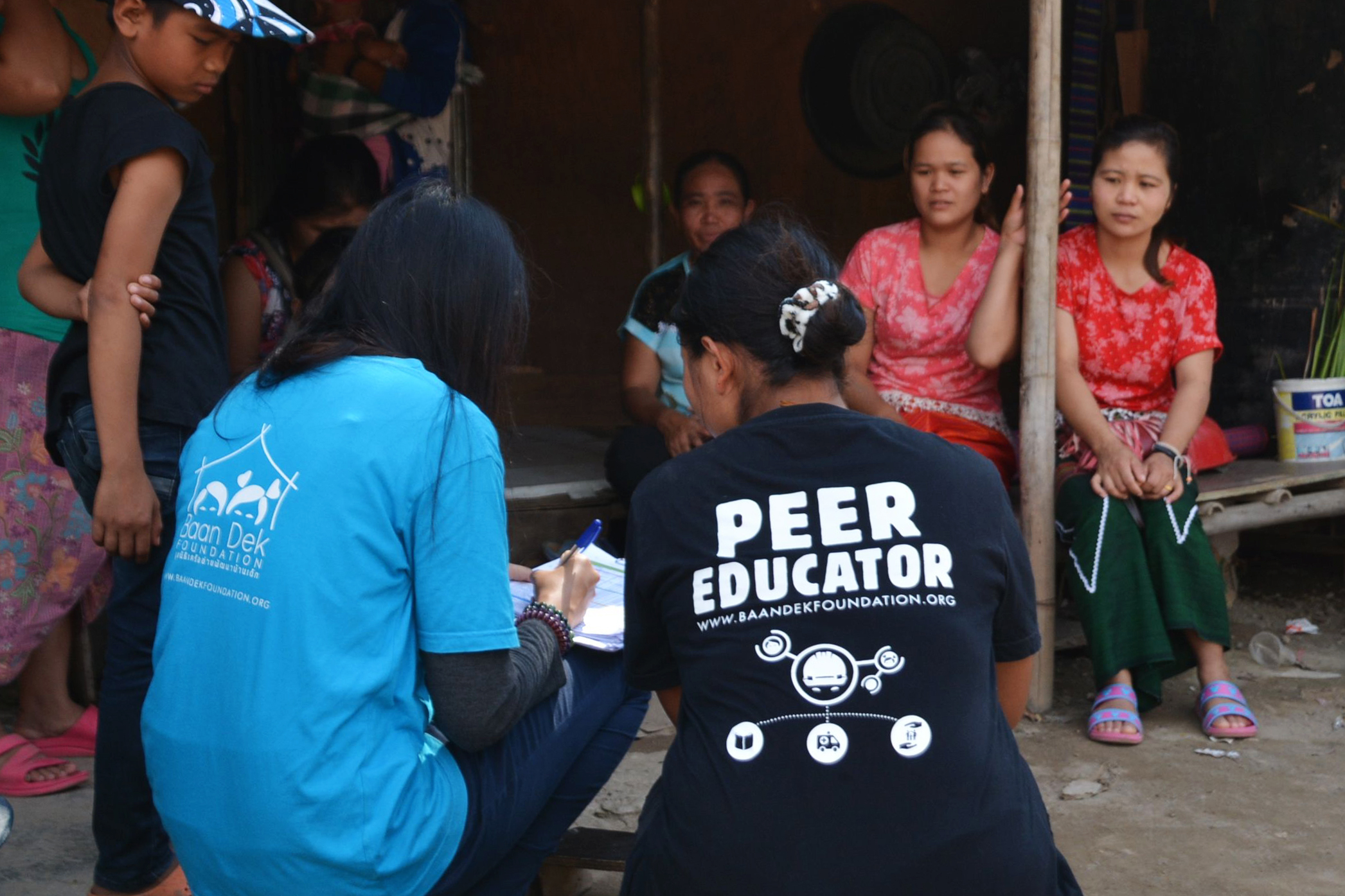 Peer Educator learning how to help her community