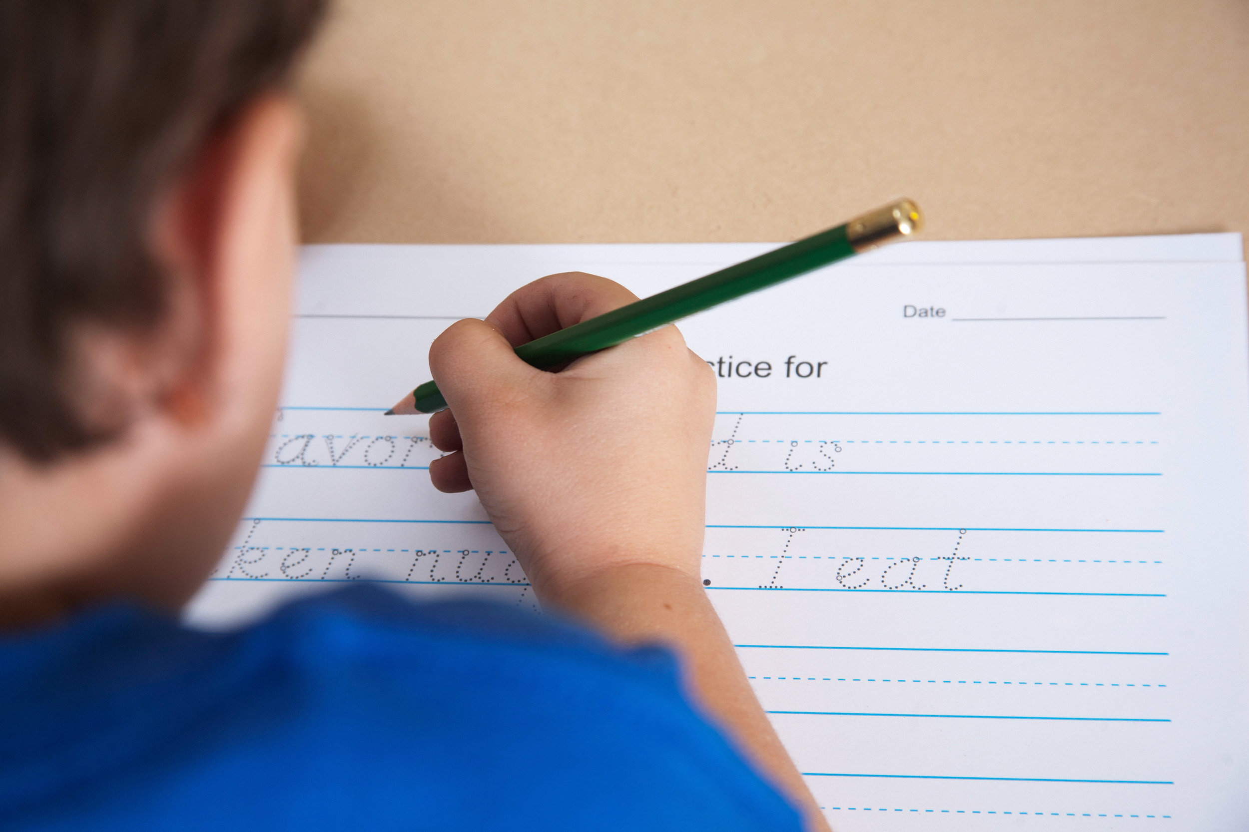 Boy handwriting in prep-readiness session