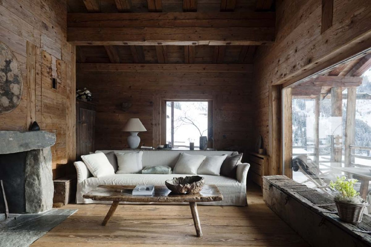 Just one example of a whole wooden room where floor, walls and ceiling have been designed with aged oak and northern pine. Furthermore, an open fireplace made with pure granite stone blocks.