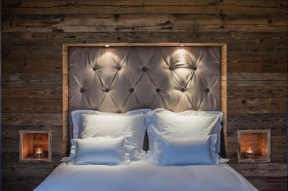 Natural, bee waxed wooden walls and small openings & bed head board, covered with velvet fabric