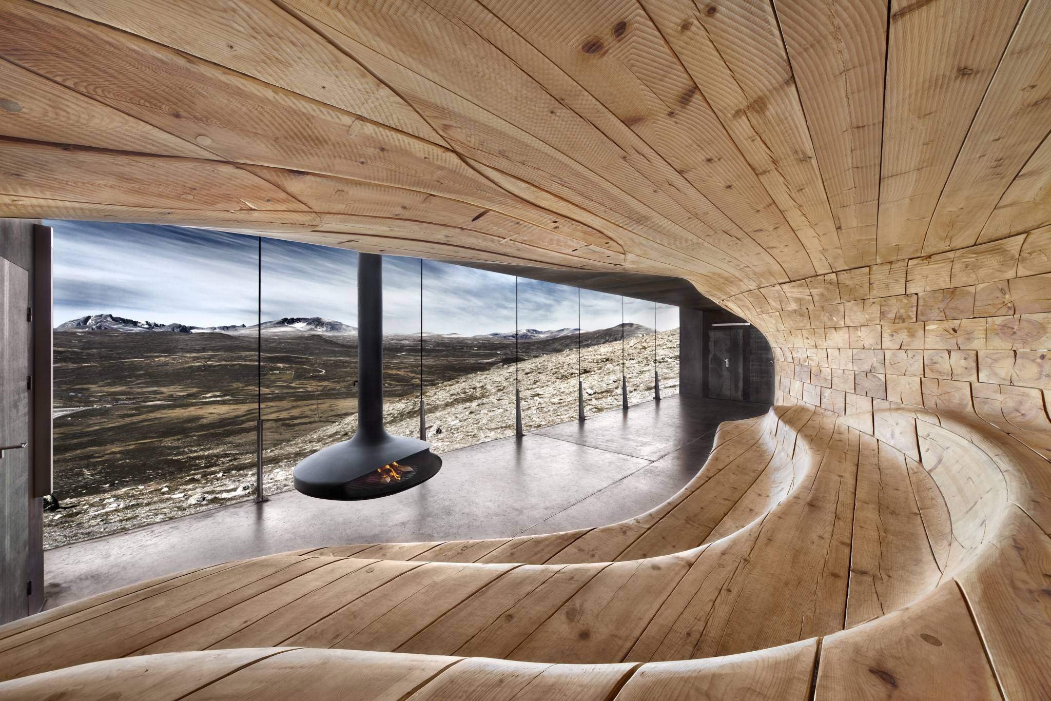 Snoehetta Architects, Oslo - reindeer Observation - nordic pine wood - waxed concrete floor with extension joints, Free hanging steel fireplace and tripled security glass windows