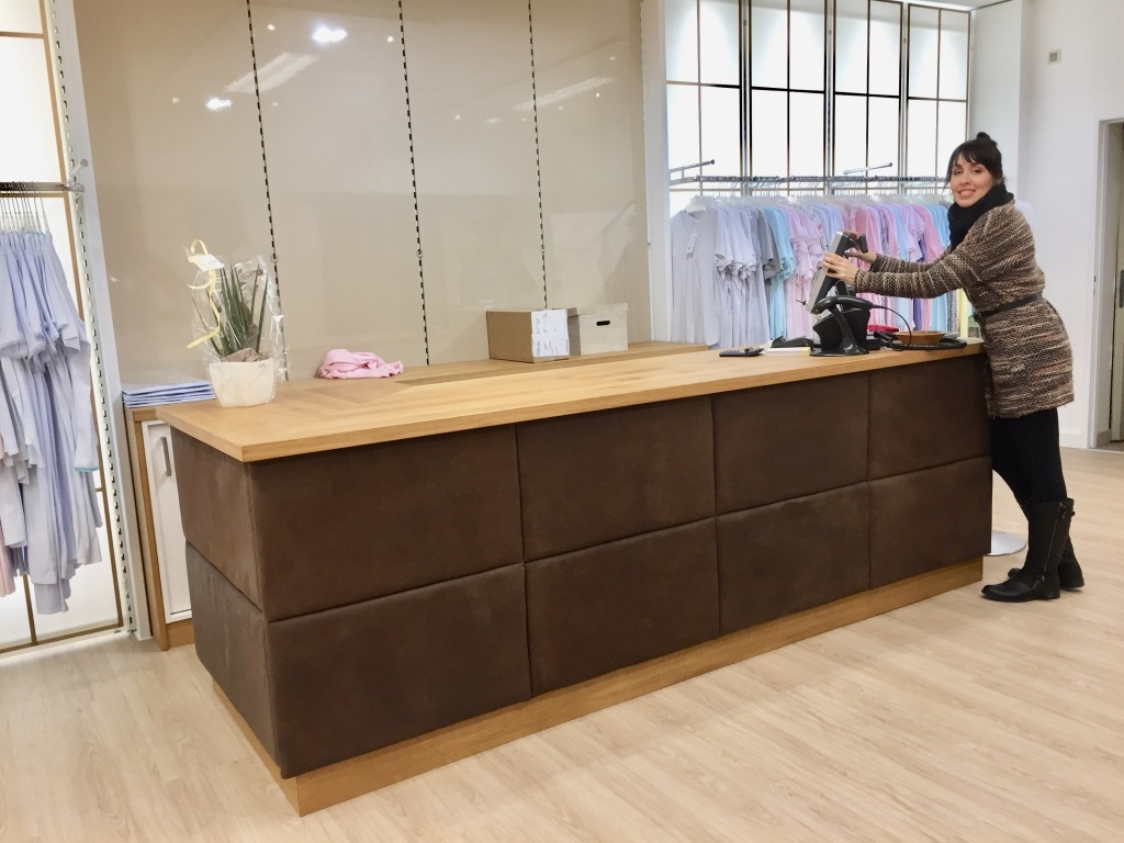 This cash counter has been custom designed. and handcrafted from natural Austrian oak wood. Front is covered with pure vegetable tanned buffalo leather on coffered system. Pictured during pre-opening. Backfront shelving will be re-designed and is still pending.  Design: Ralph Budwell - www.budwell-creations.com