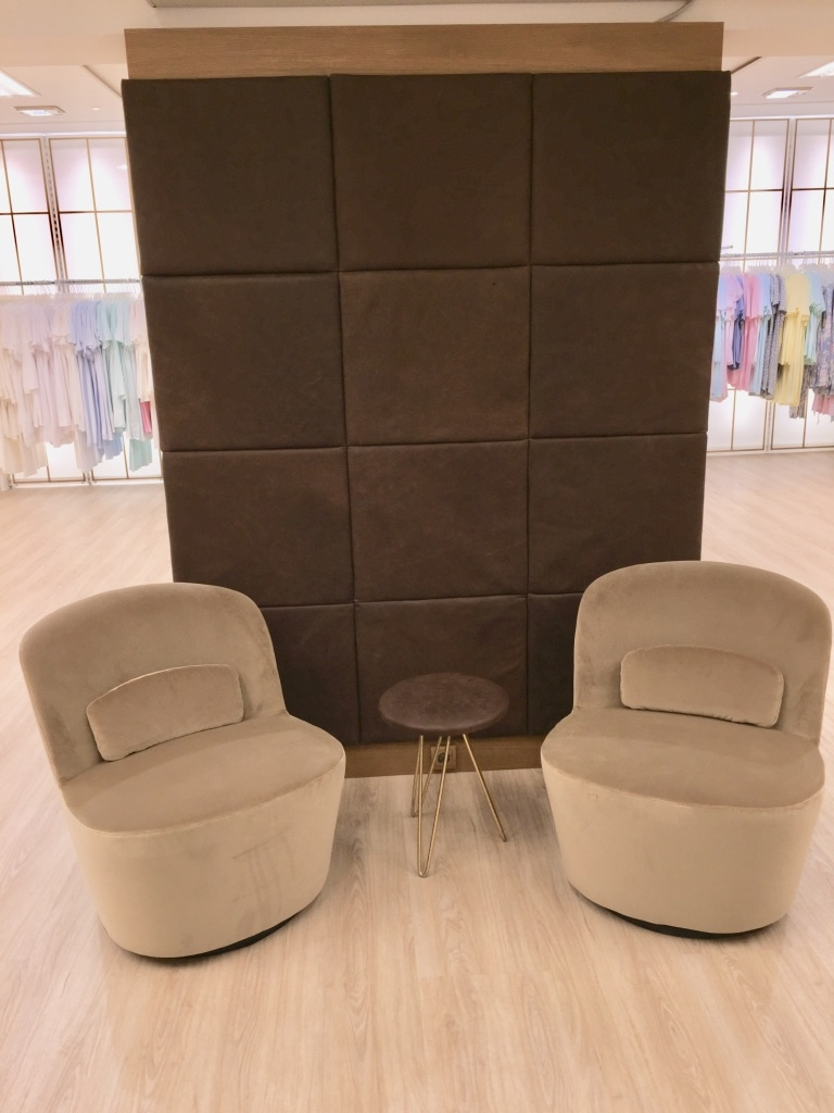 Visitor corner at Lingerie/Dessous store. Velvet 60` chairs on moveable/rotatable platform. Pure vegetable tanned leather application placed on room divider.  Design: Ralph Budwell (www.budwell-creations.com)
