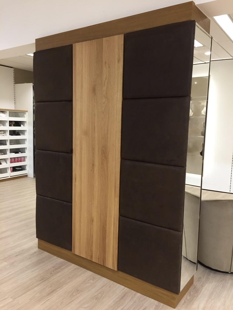 Wardrobe/ room divider with integrated shelving. Designed around - embedded brick column. Front door: natural Austrian oak wood, oiled. Left and right application, cassette system - handcrafted covered with natural vegetable tanned buffalo leather