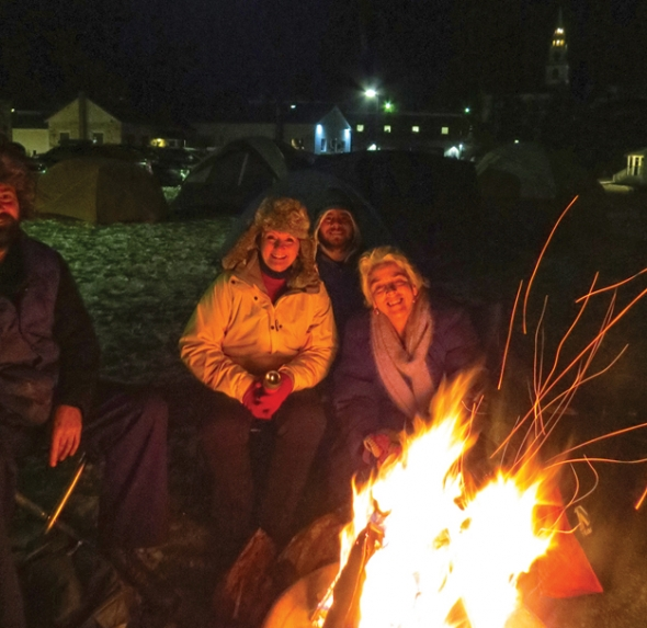 PICTURED ARE SOME of the three dozen people who spent a chilly night in tents at Middlebury's Marble Works complex last December to get a feel for homelessness and to raise money to bring homeless people in off the street. A second sleep-out is planned for Dec. 5. File photo by May Morris