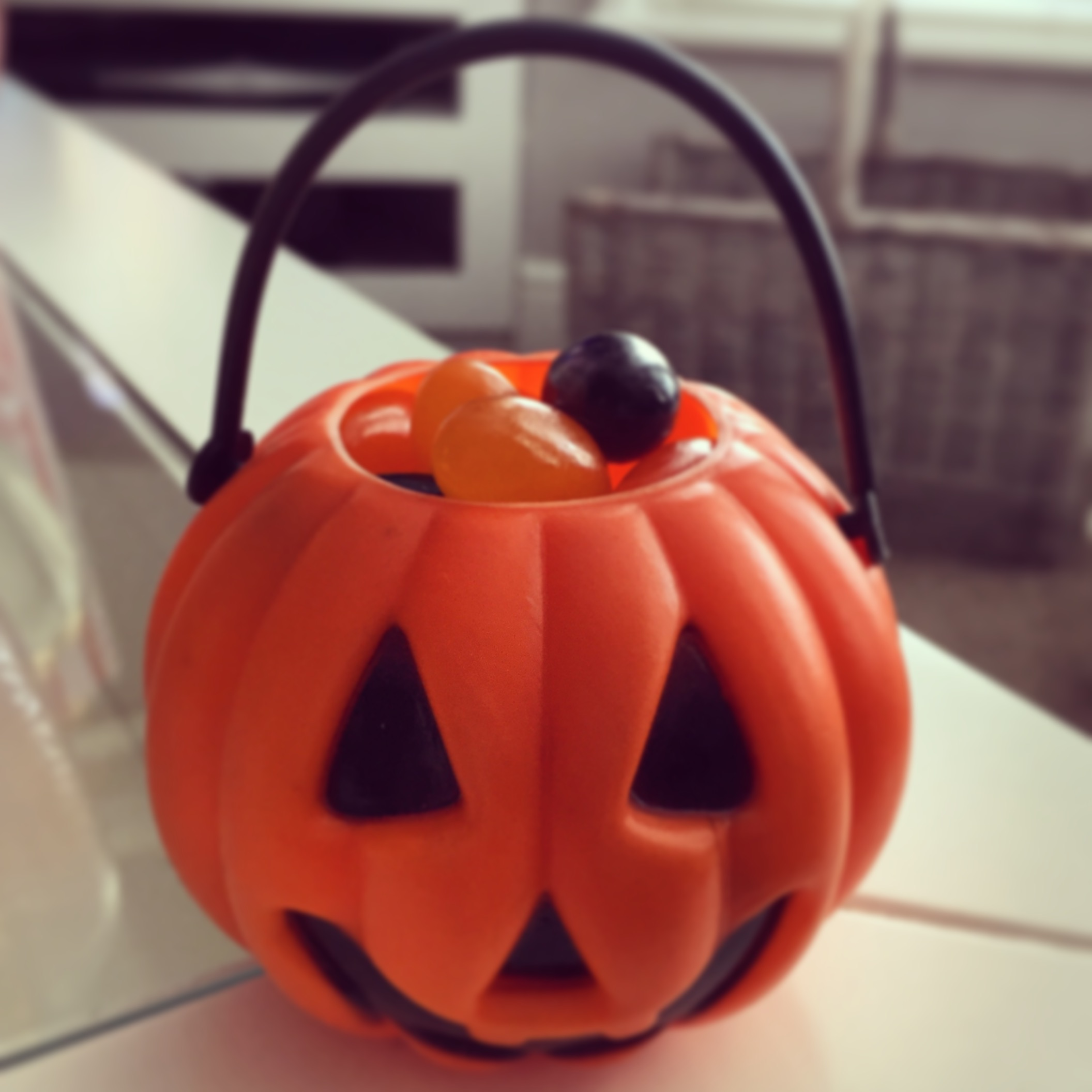 Give your guests individual mini pumpkins filled with black and orange jelly beans.